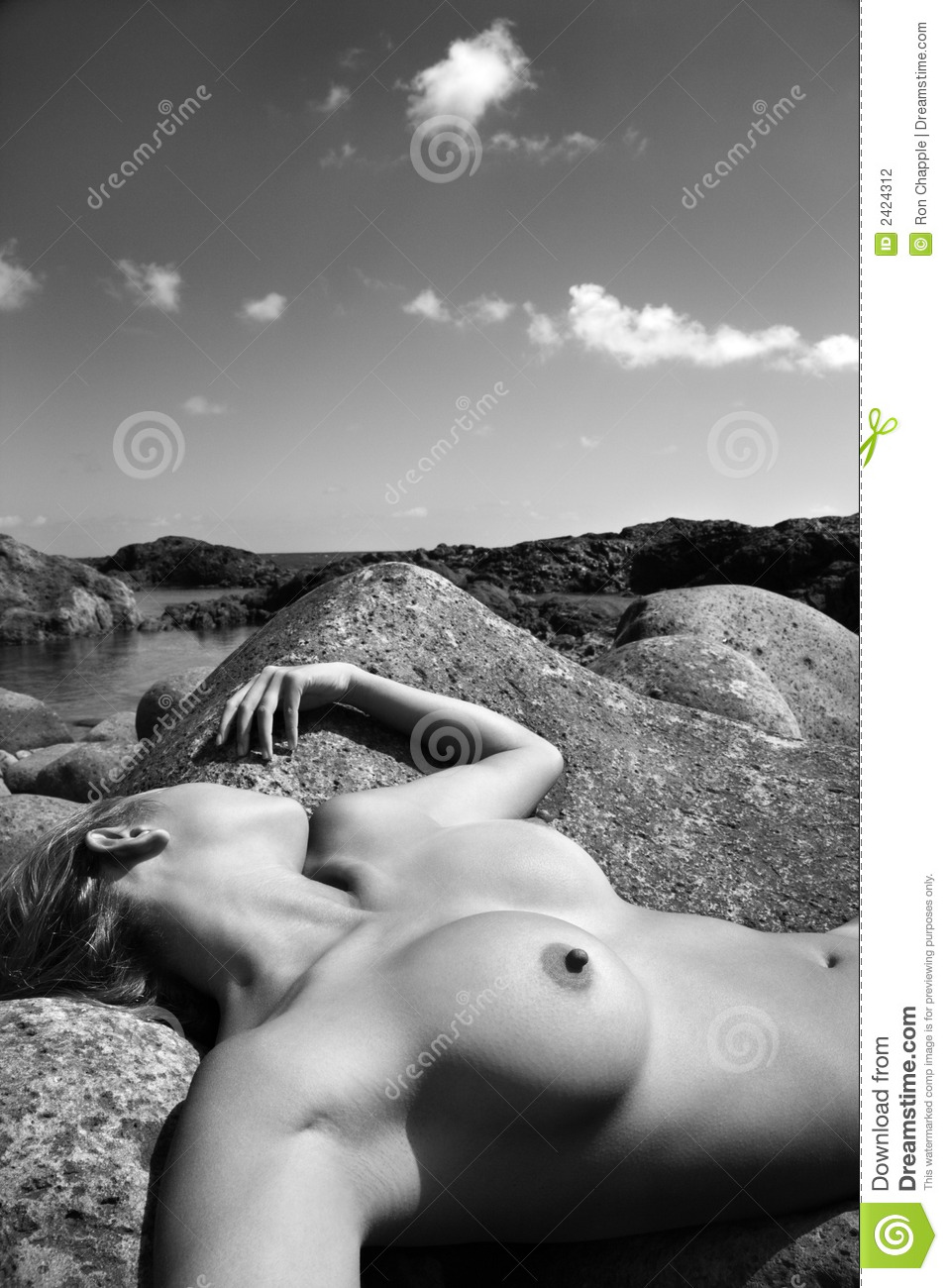 Young Nude Asian Woman Lying On Back Rock With Face Turned Away