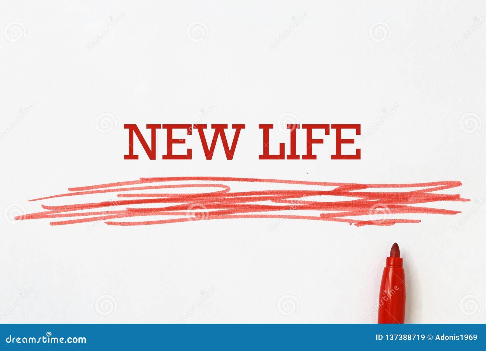Nuevo lema de la vida escrito con la pluma roja
