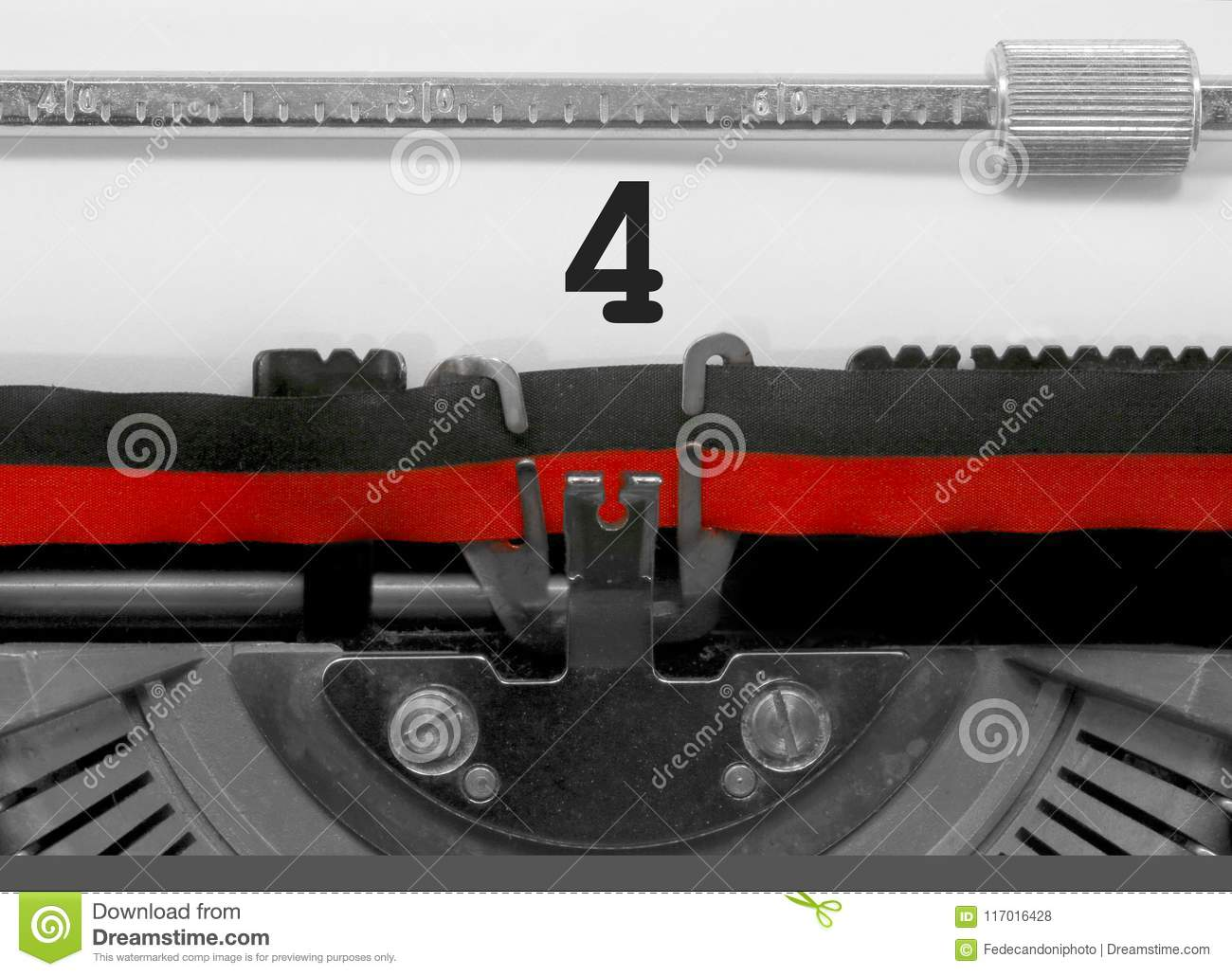 4 Number by the old typewriter on white paper
