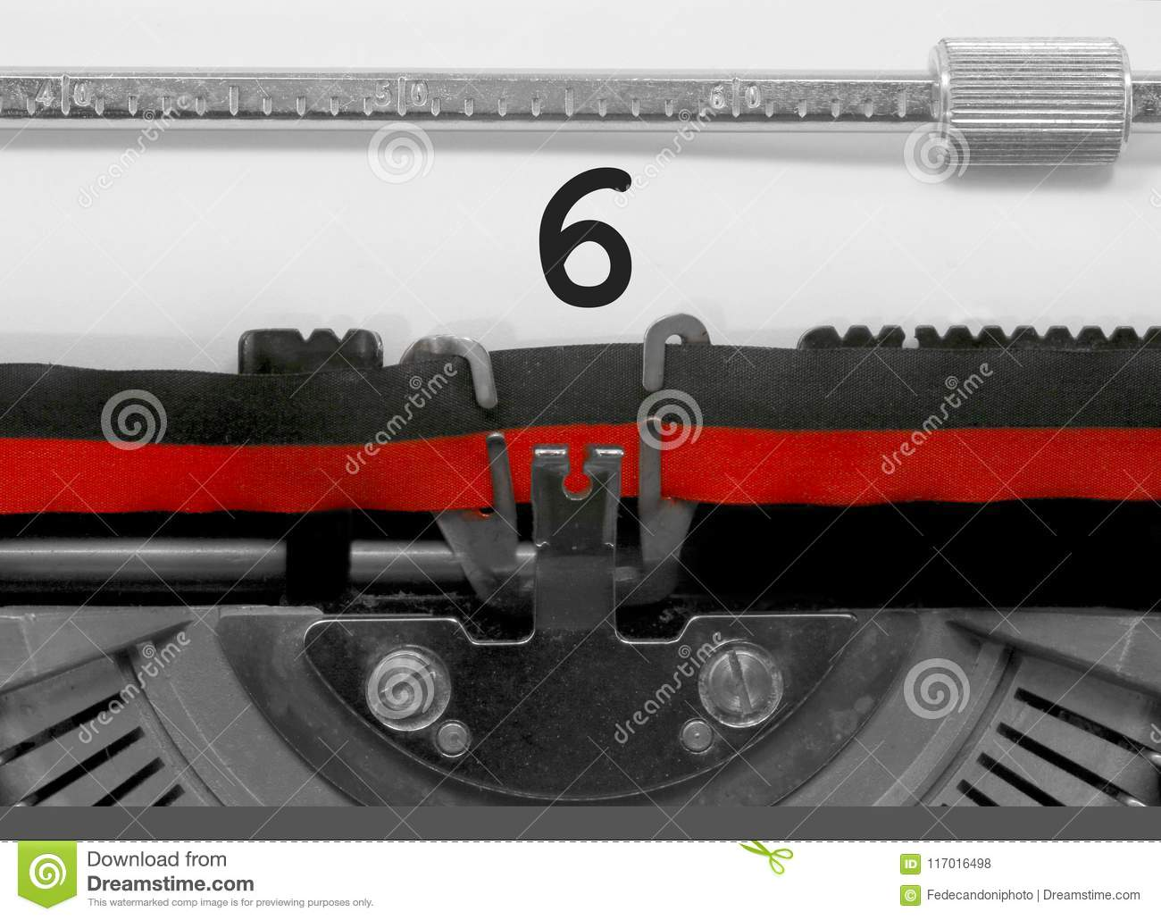 6 Number by the old typewriter on white paper