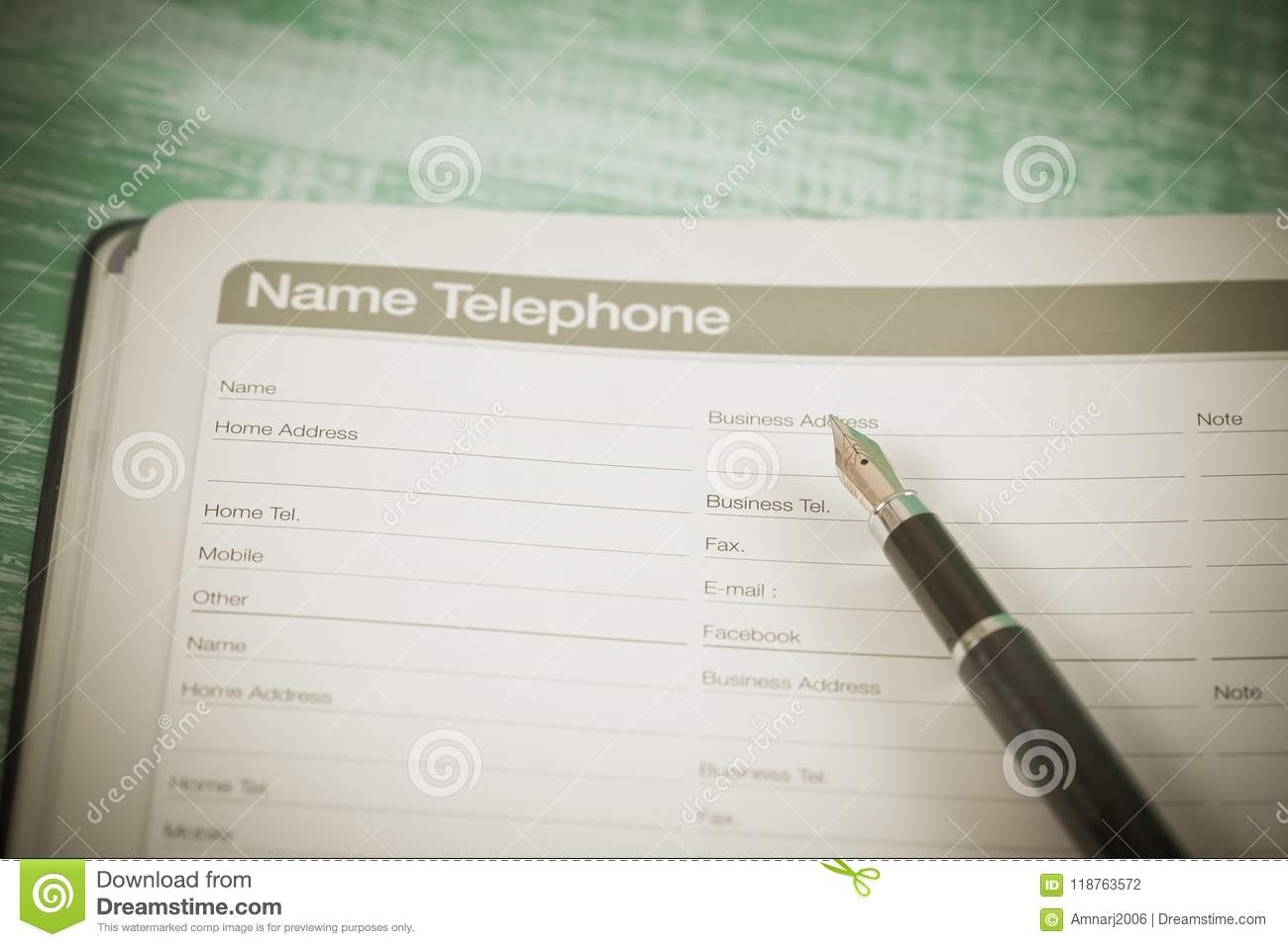 number telephone list on page of diary book planner stock photo