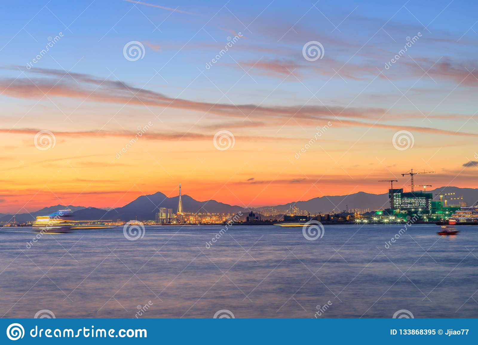 Evening and night view of magnificent cityscape on both sides of Victoria Harbour Hong kong