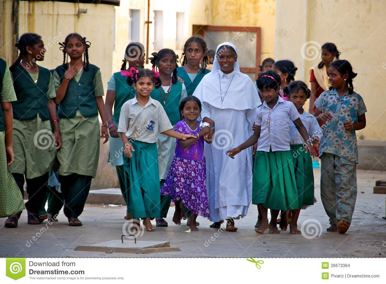 Nun with orphan children in India