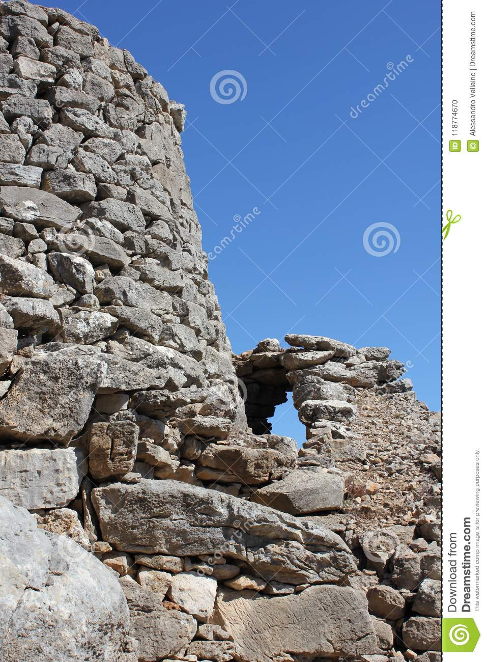 Nuraghe is a typical ancient rock building of the Sardinia island - Italy