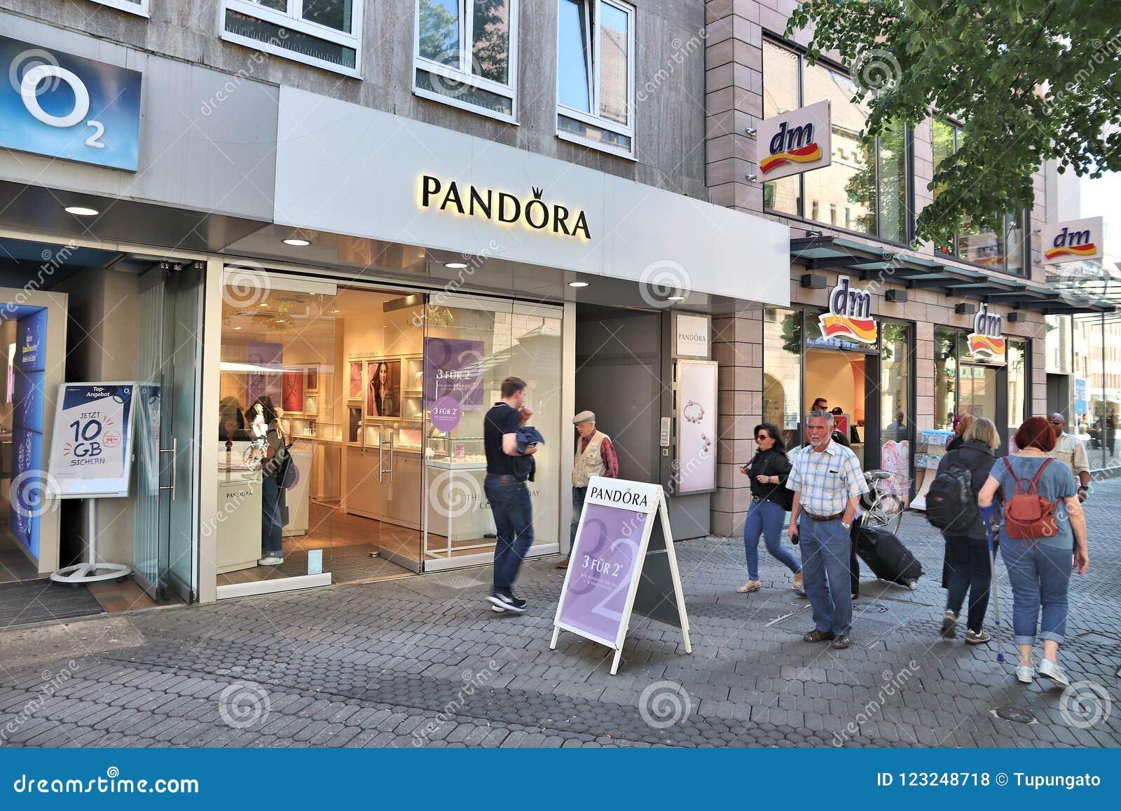8e3974f21 NUREMBERG, GERMANY - MAY 7, 2018: People walk by Pandora jewelry store at  Karolinenstrasse shopping street in Nuremberg, Germany.