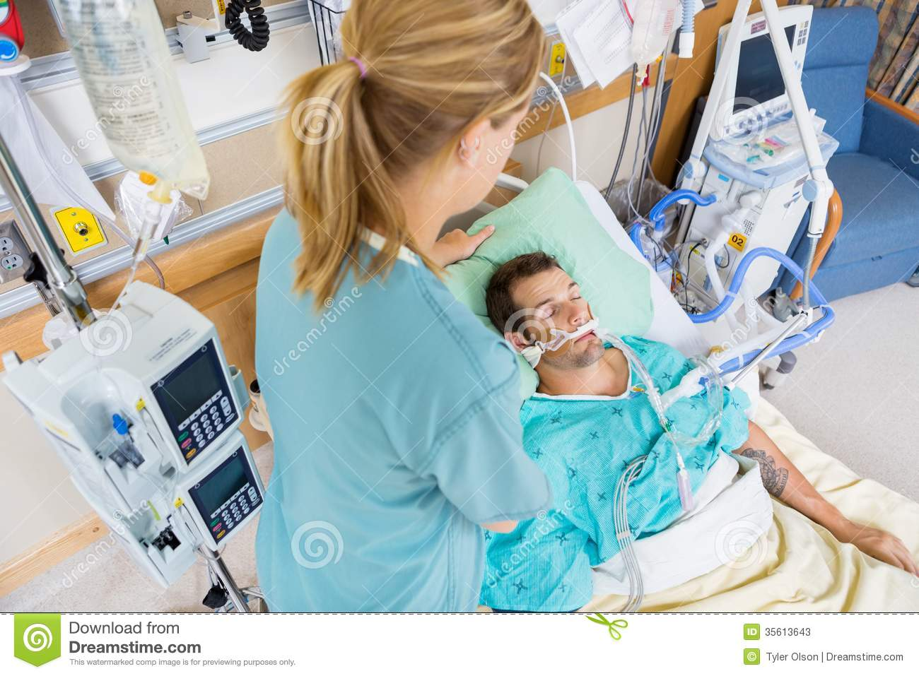 Nurse Adjusting Young Patient S Pillow In Hospital Stock