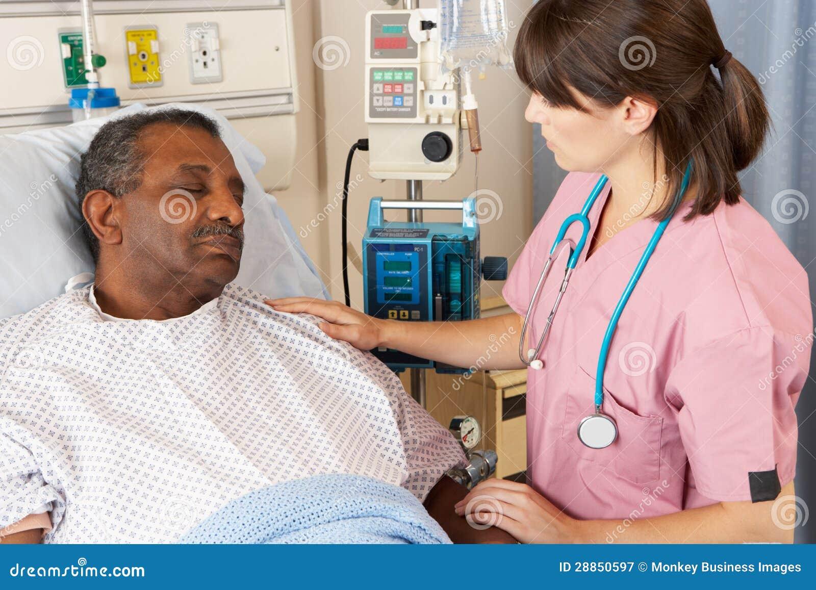 Nurse Checking Senior Patient On Ward Royalty Free Stock ...
