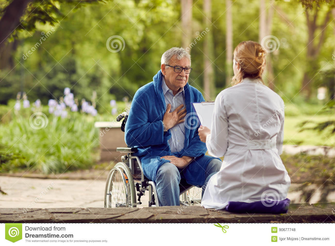 Nurse with elderly man in wheelchair who don`t feel good