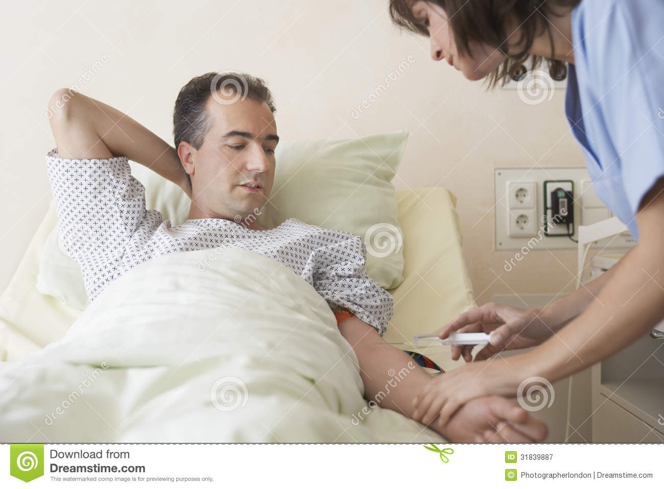 Male Patient On Hospital Bed