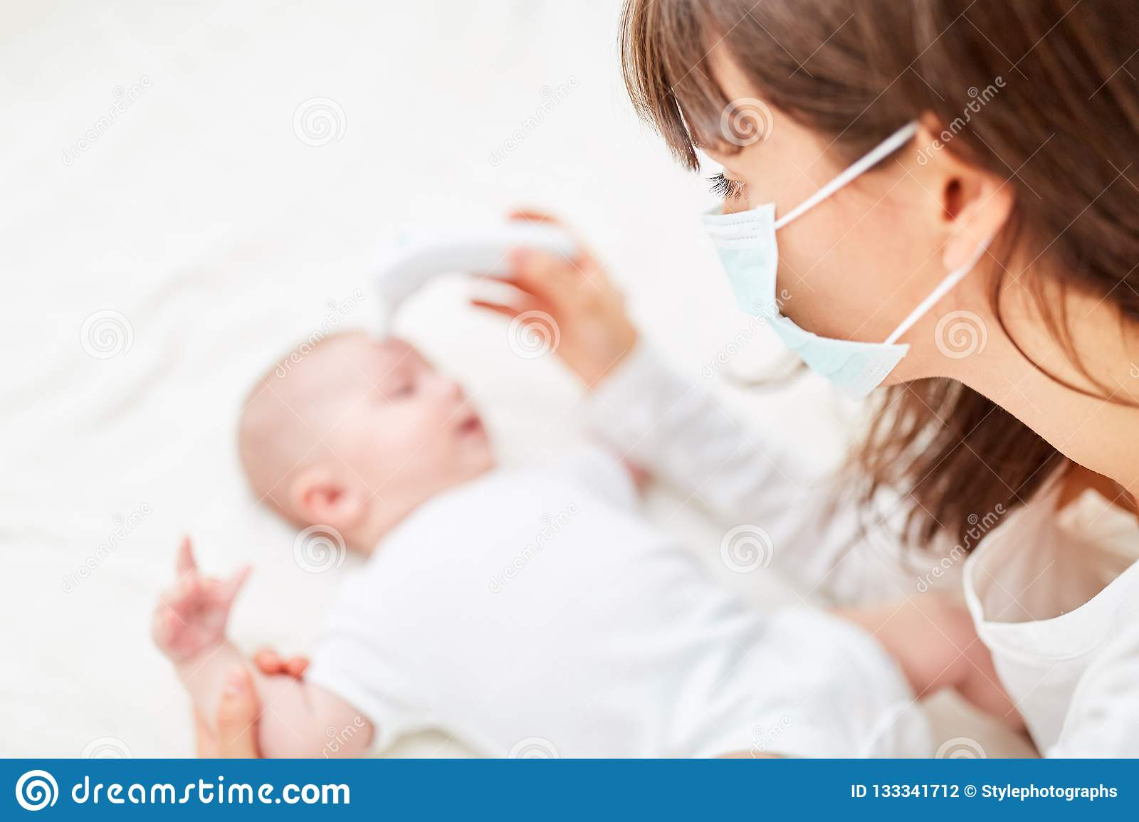 Baby Stock With Fever Measures Female Surgical Doctor In Mask