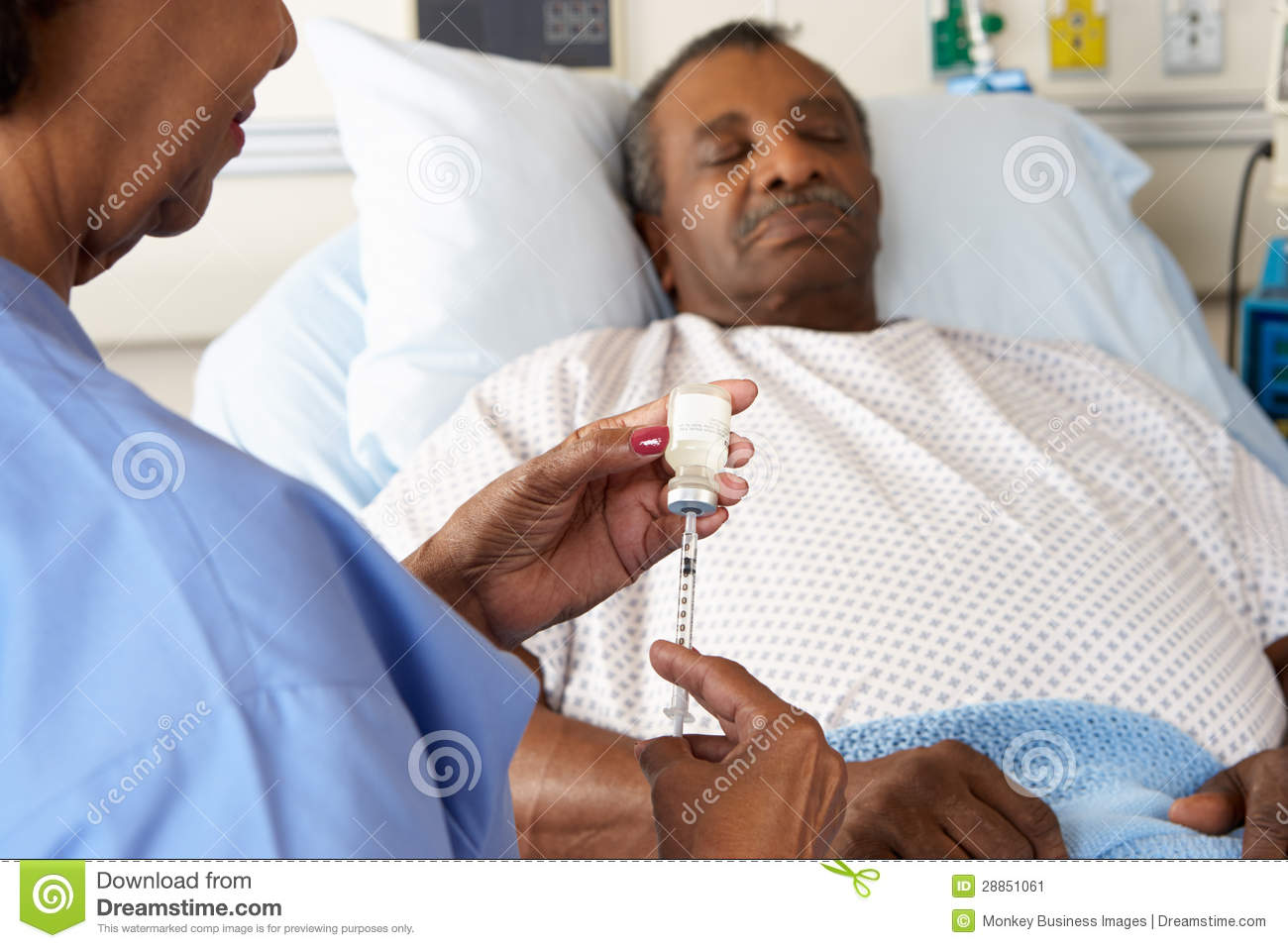 Nurse Preparing To Give Senior Male Patient Injection