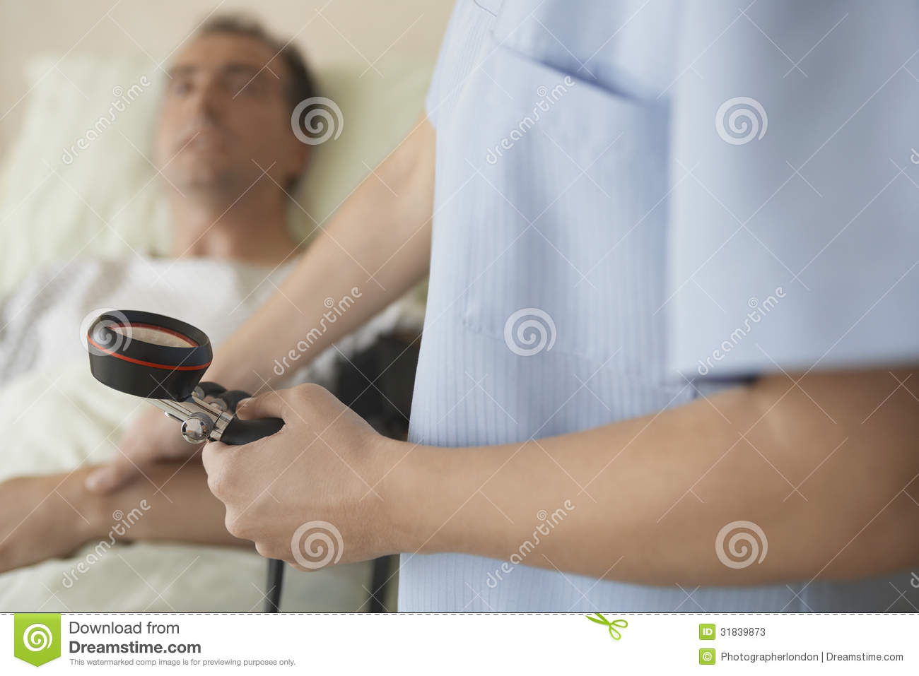 Nurse Taking Blood Pressure And Pulse Of Patient Stock ...