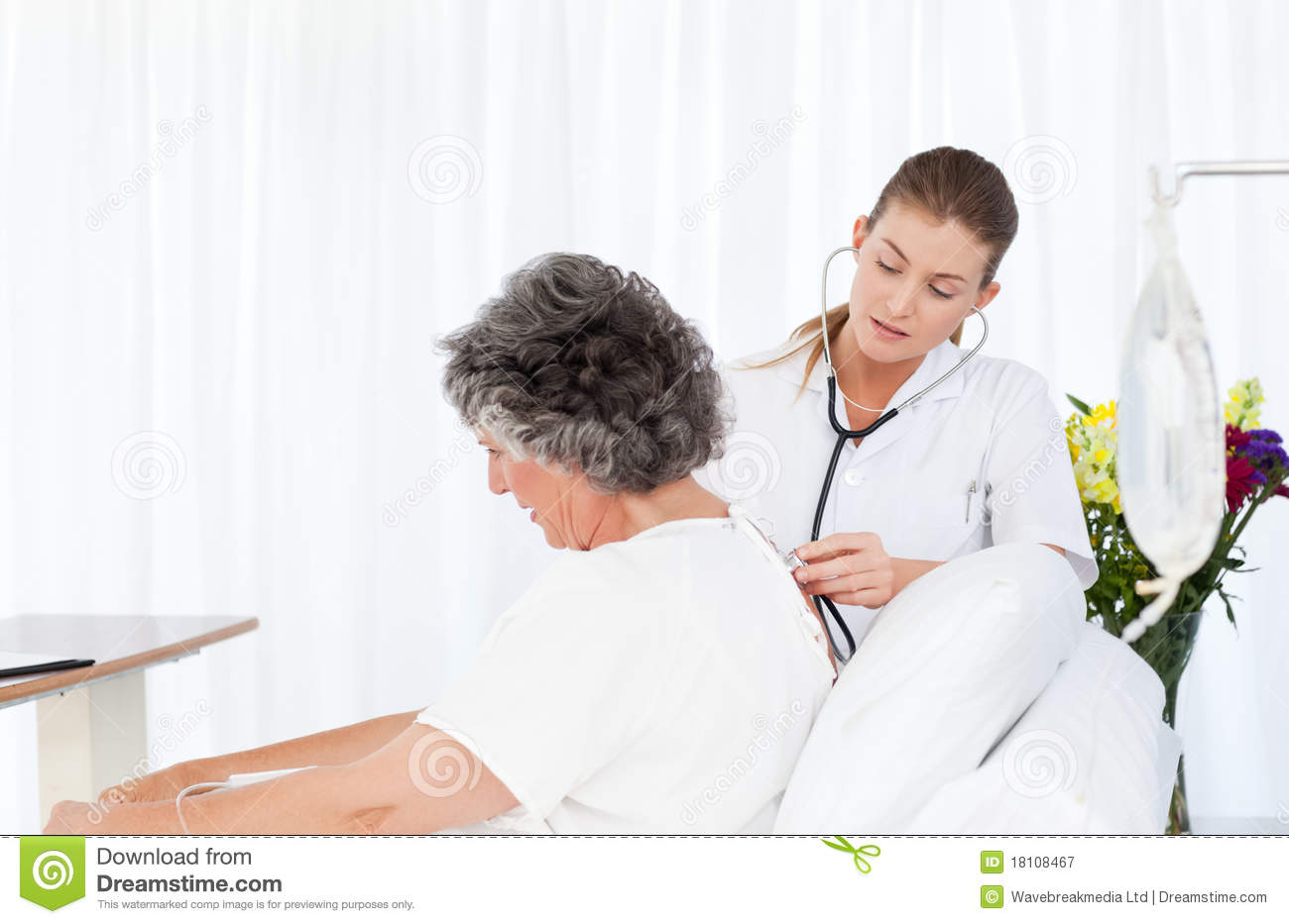 Nurse Taking Care Of Her Patient Royalty Free Stock ...