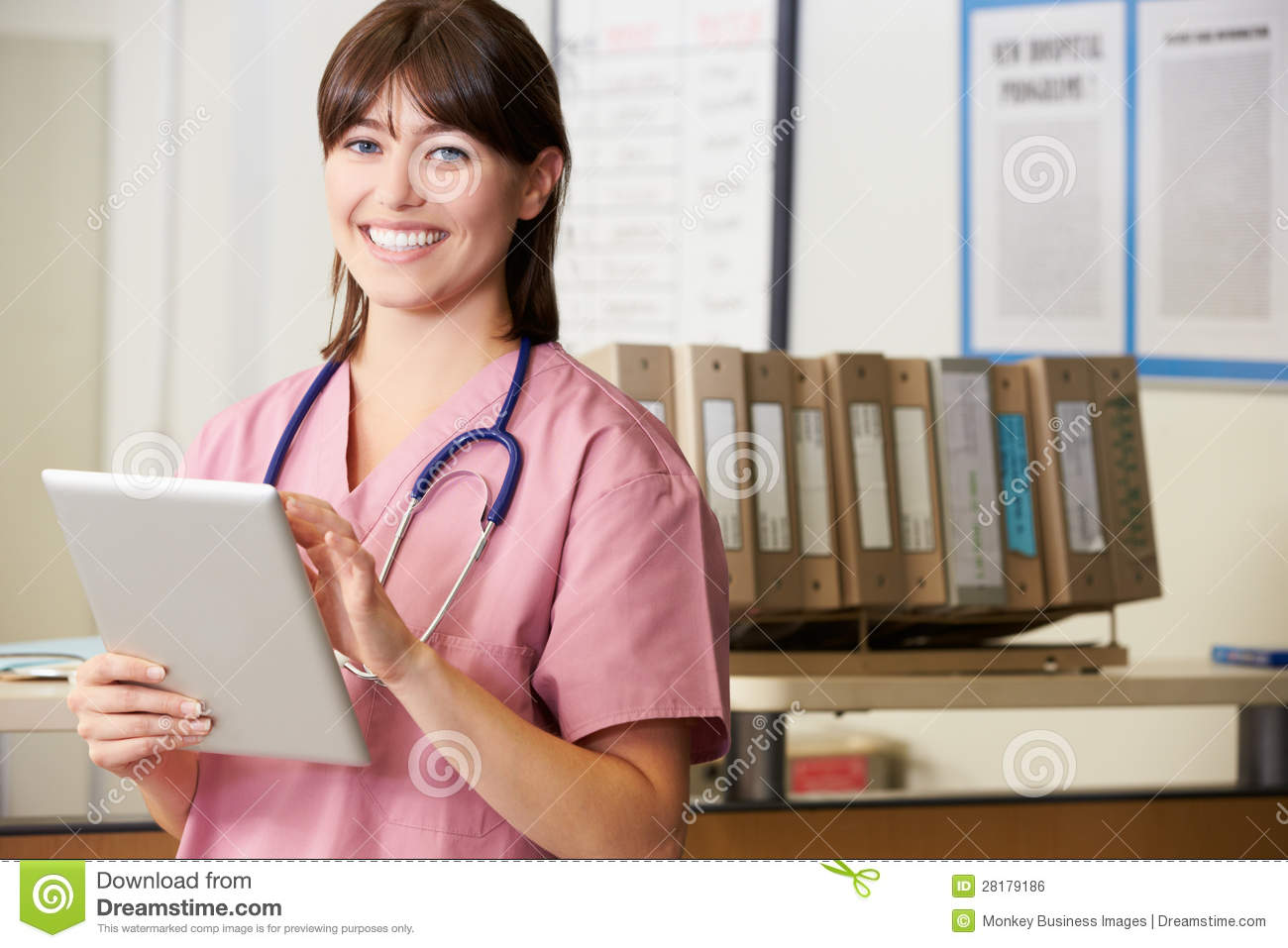 Nurse Using Digital Tablet At Nurses Station