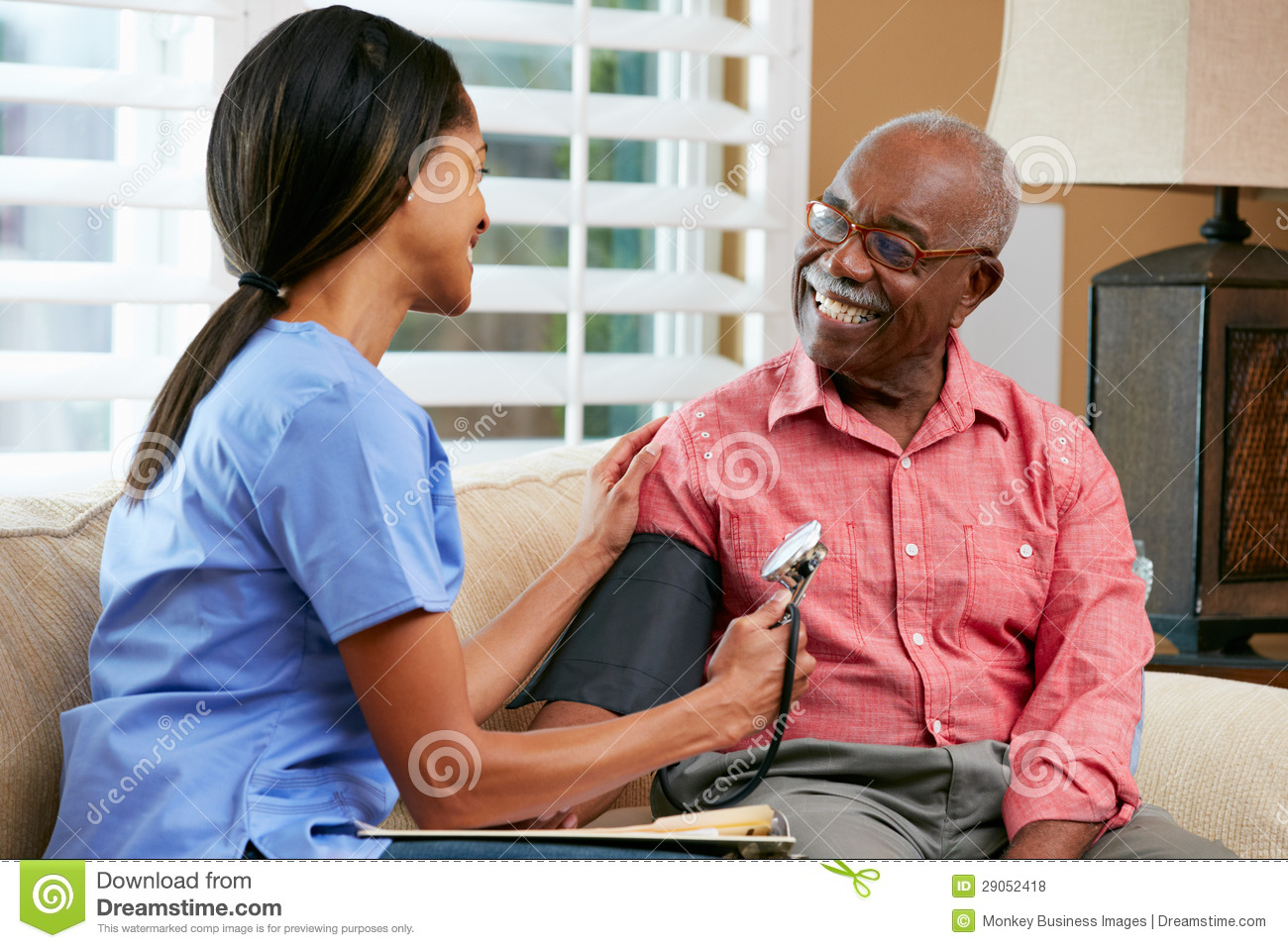 Nurse Visiting Senior Male Patient At Home Royalty Free