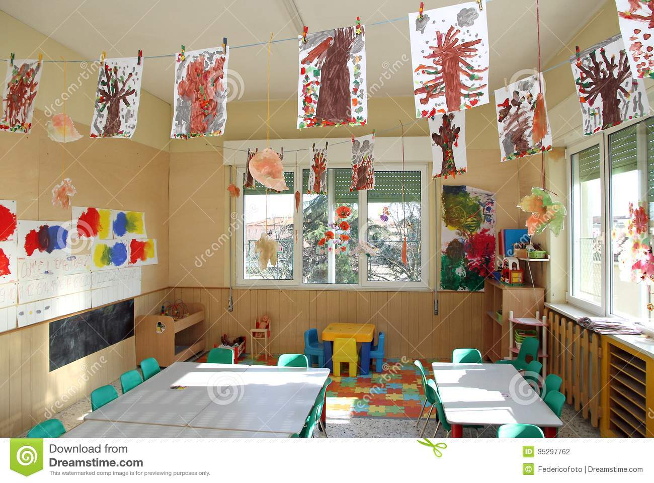 Nursery Class Of Children With Many Drawings Of Trees