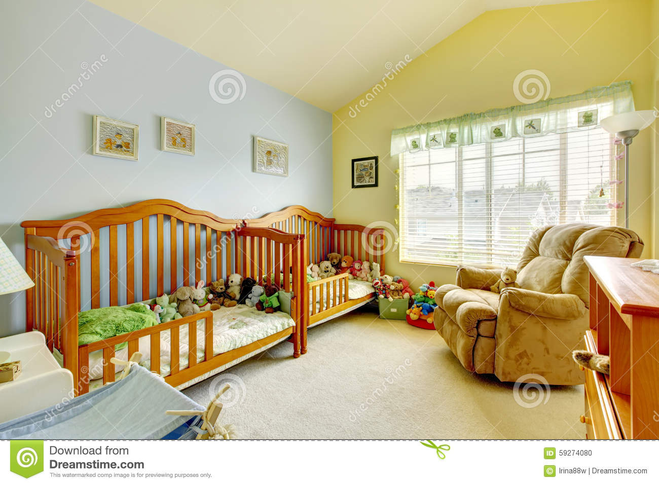 Nursery Room With Two Cribs For Twins And Lots Of Toys