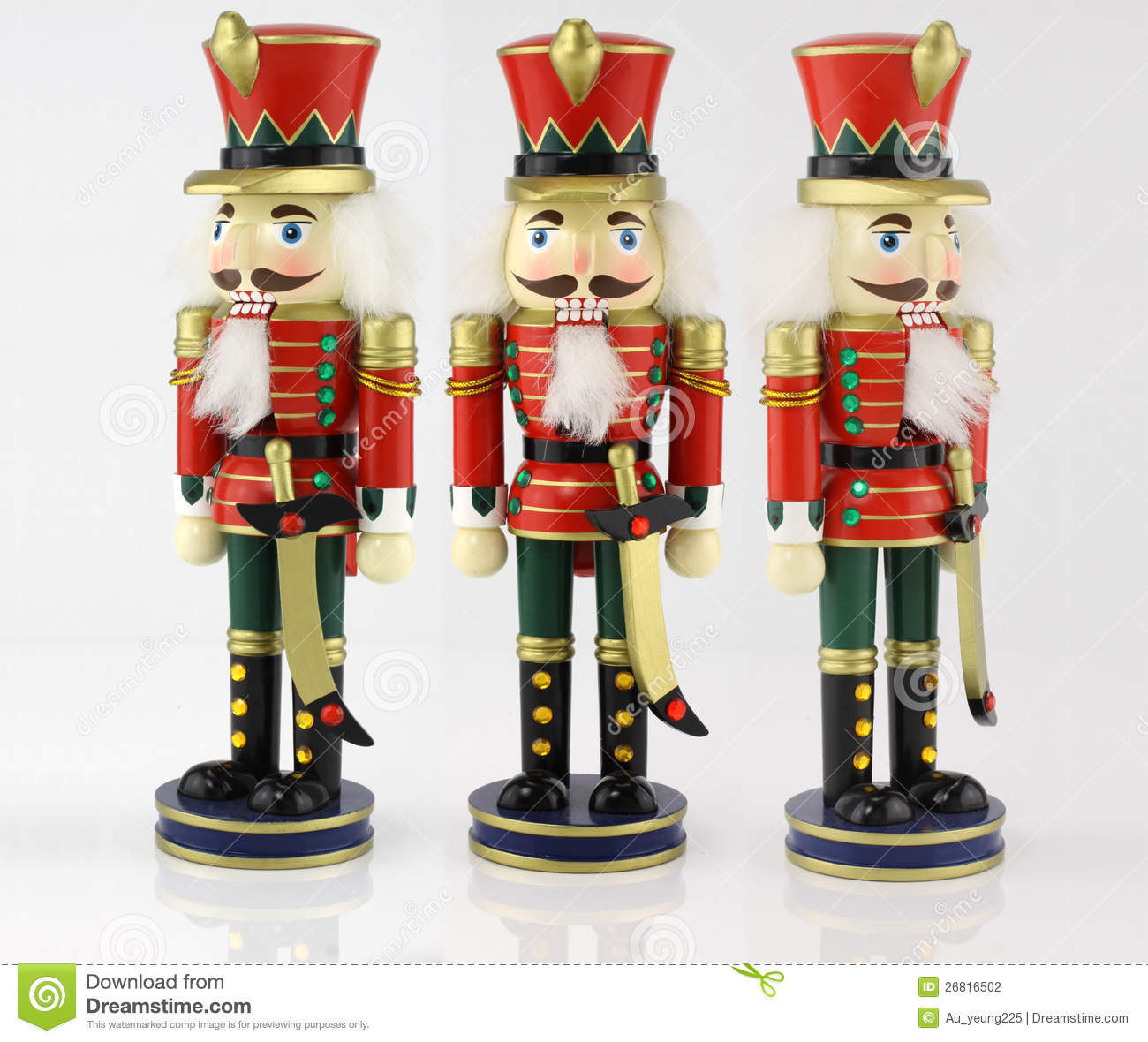 Traditional nutcracker doll on a white background.