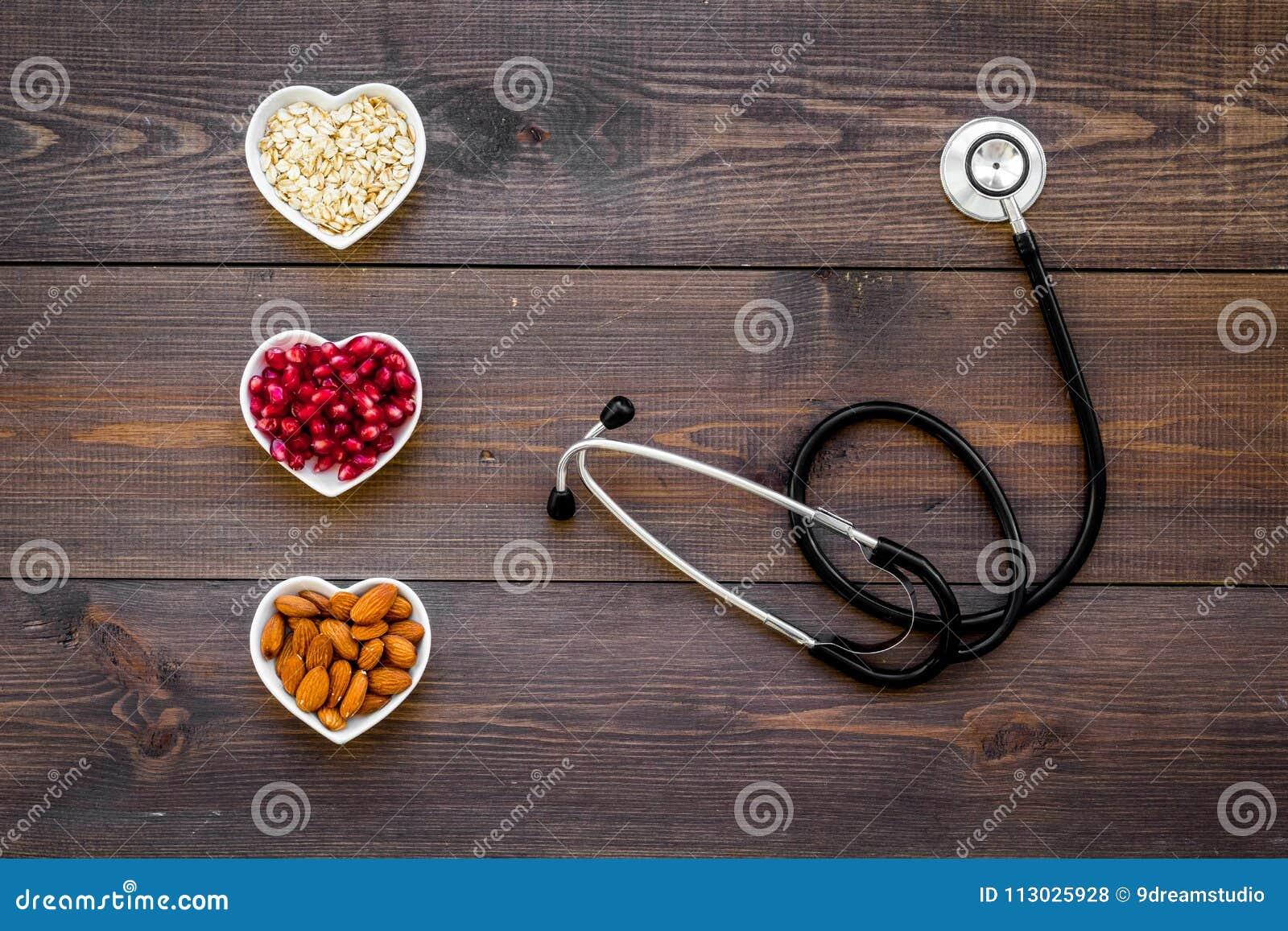 Nutrición apropiada para los pathients con enfermedad cardíaca El colesterol reduce dieta Harina de avena, granada, almendra en f