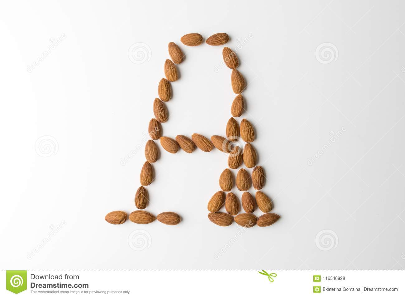 Nuts, almond, tasty and healthy food with lots of vitamins. Almond nuts placed in form of letter A. Concept design
