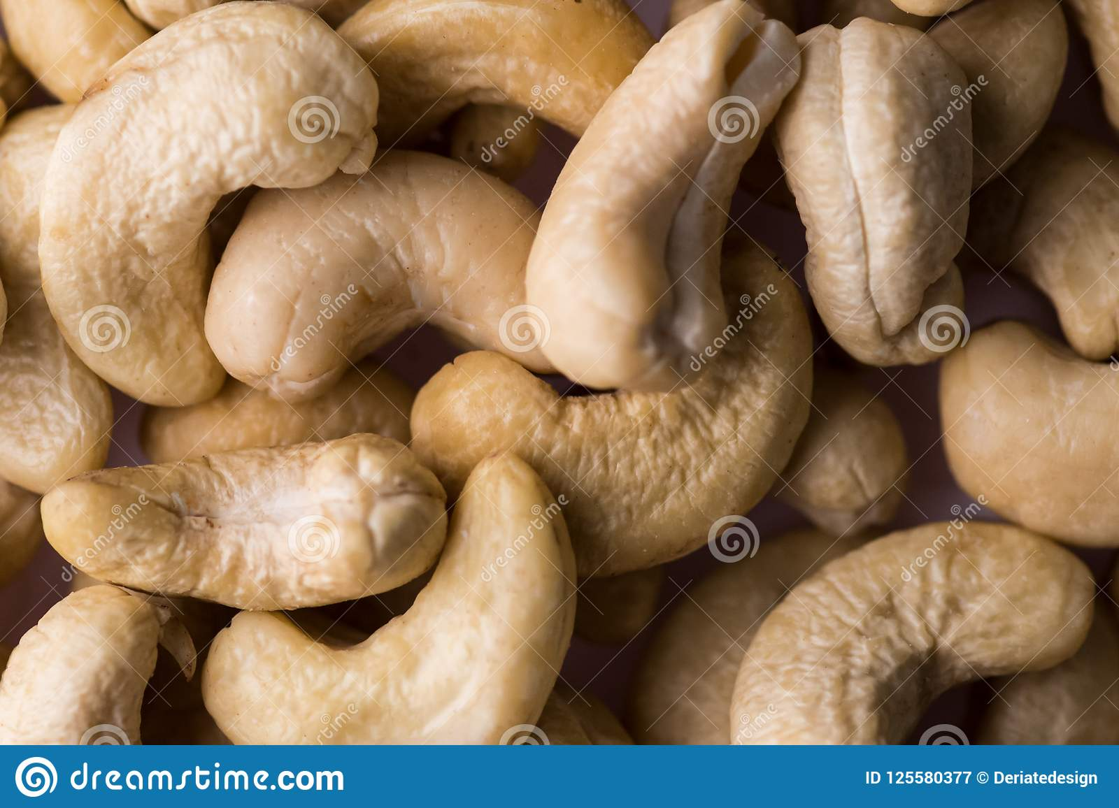 Nuts, cashew, tasty and healthy food with lots of vitamins. Close up view, selective focus over the nuts