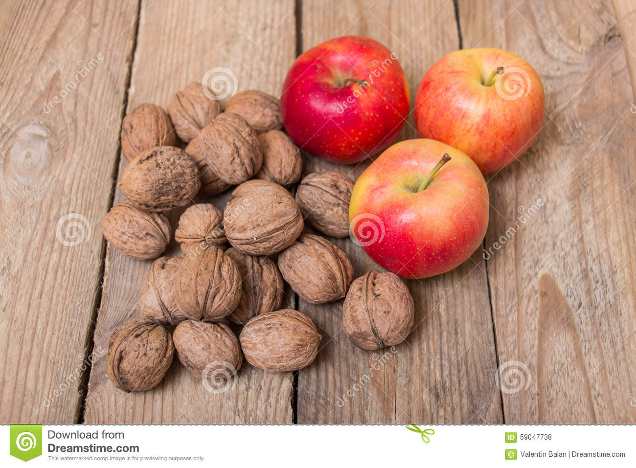 ff455cfcb16d Nuts And Red Yellow Apples On A Wooden Background Stock Photo ...