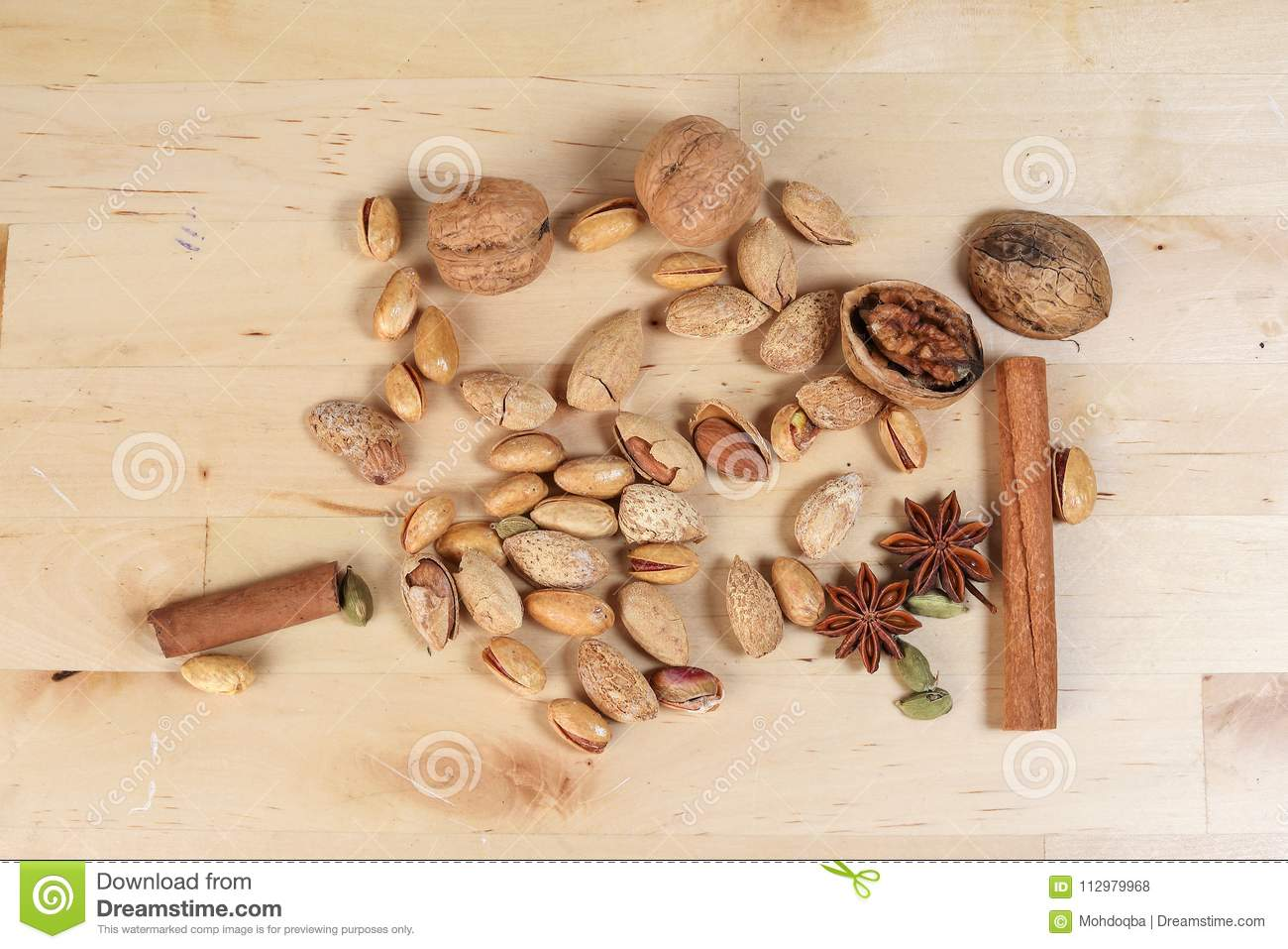 Nuts spice mix on rustic wood