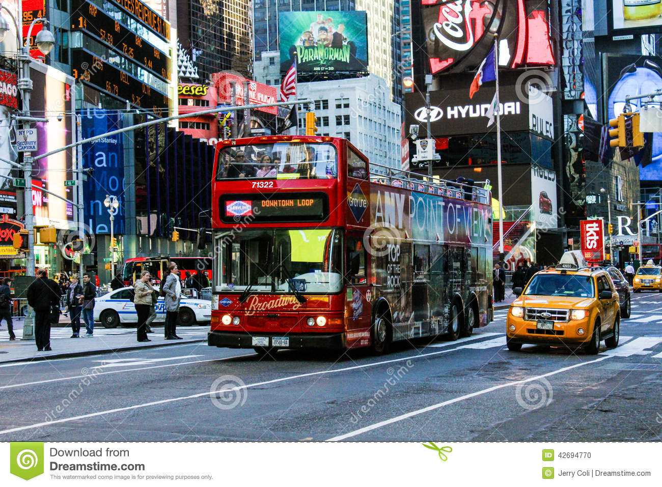 • Double-decker tour of the bright lights of NYC • Open air top deck that puts you in the center of the action • hour tour • See the iconic attractions lit up at night.