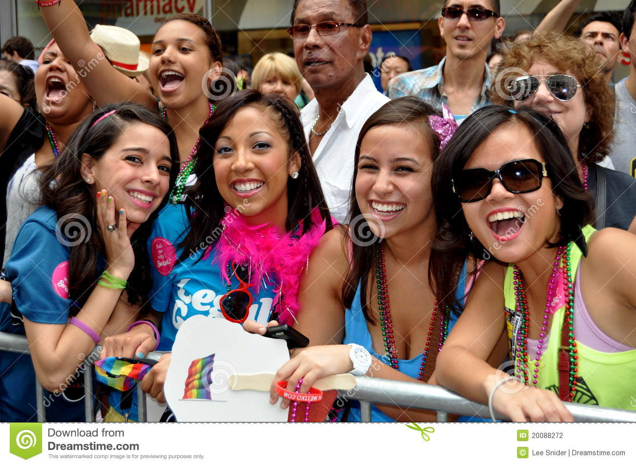 smiling young women having a great time viewing the Gay Pride Parade on Fifth Avenue in