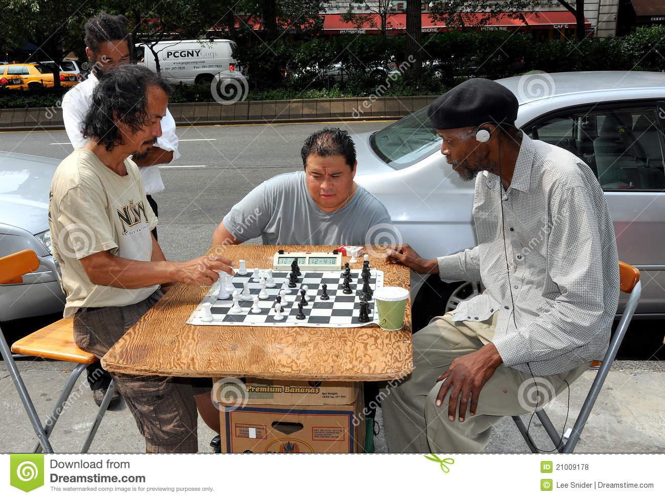 NYC: Men Playing Chess On The Street Editorial Stock Photo