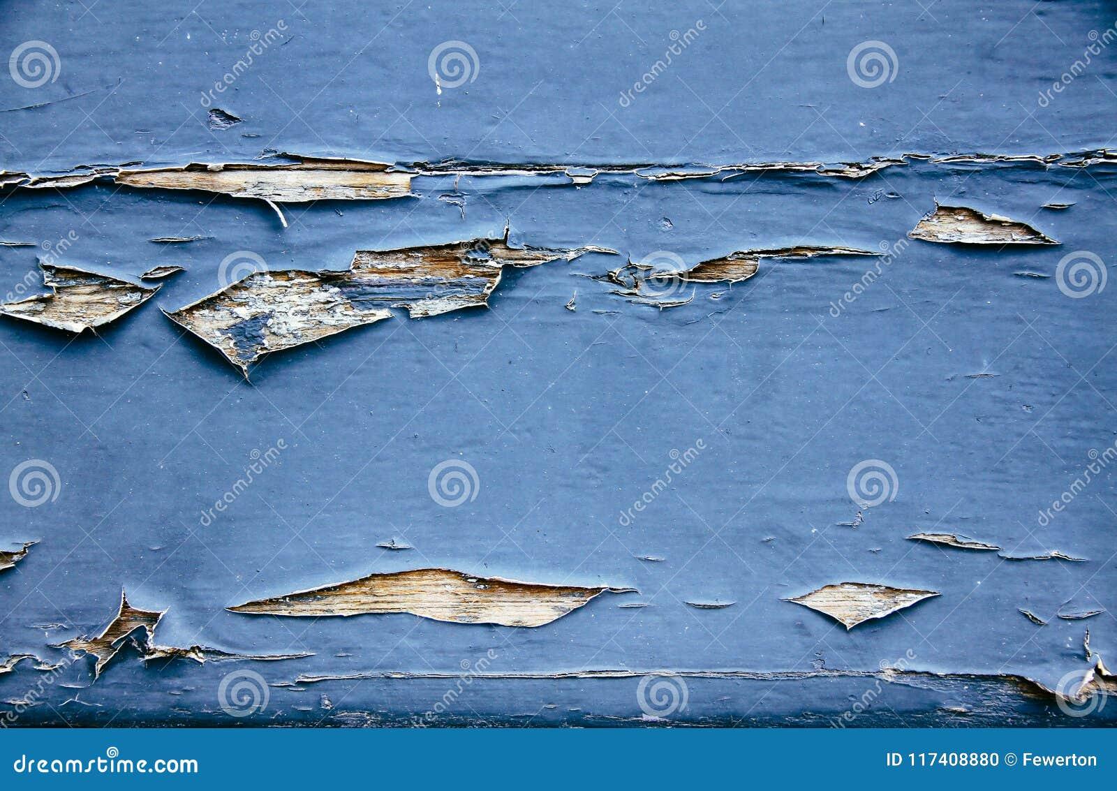 O azul sujo e resistido velho pintou o fundo de madeira da textura da prancha da parede marcado pela exposição longa aos elemento