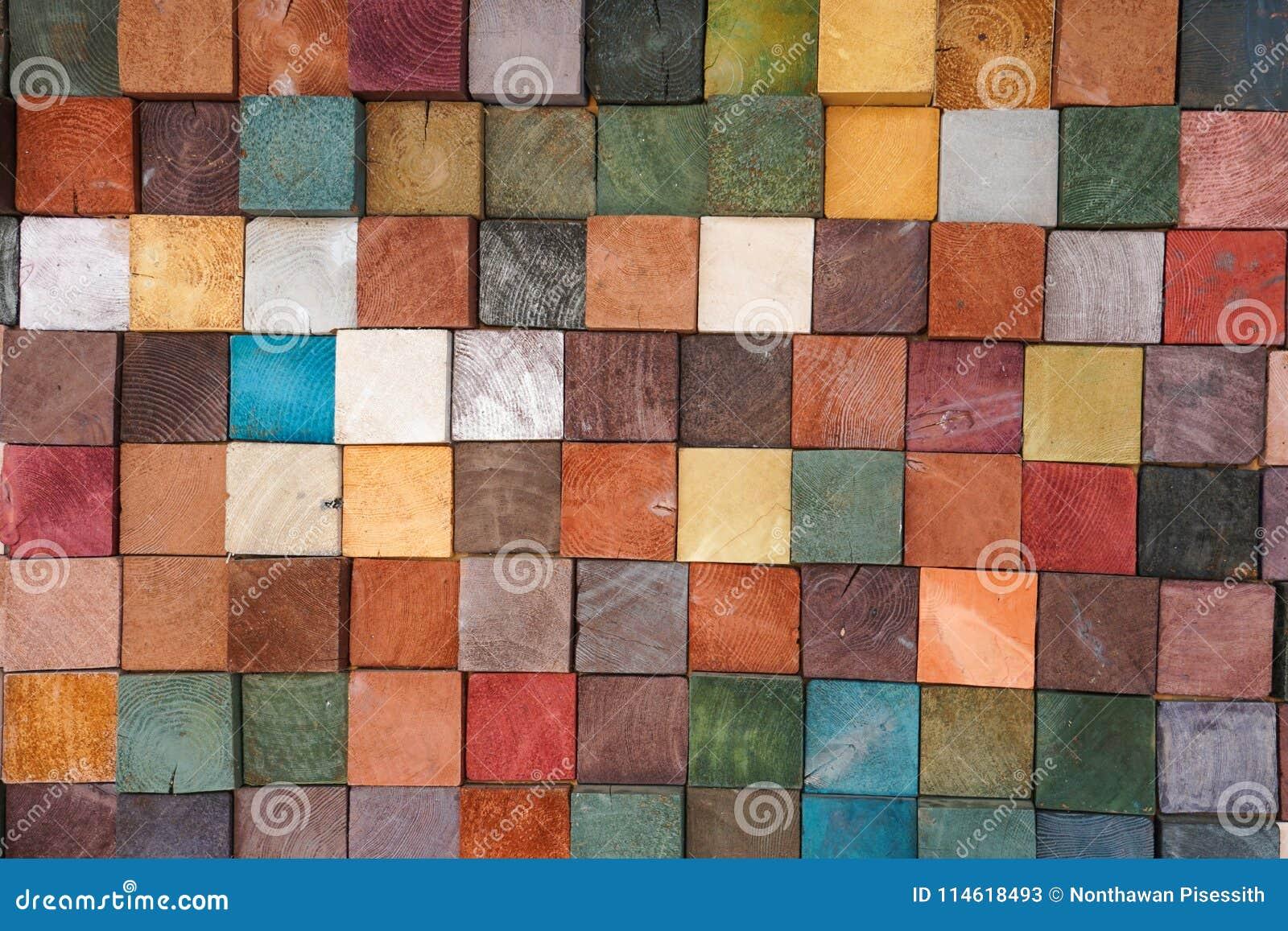 O bloco de madeira colorido telha o fundo abstrato dos testes padrões