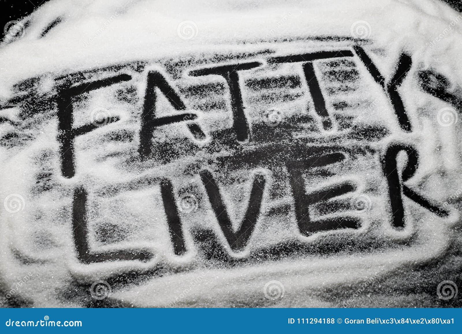 O fígado gordo das palavras escrito com e em grões do açúcar, açúcar é kno