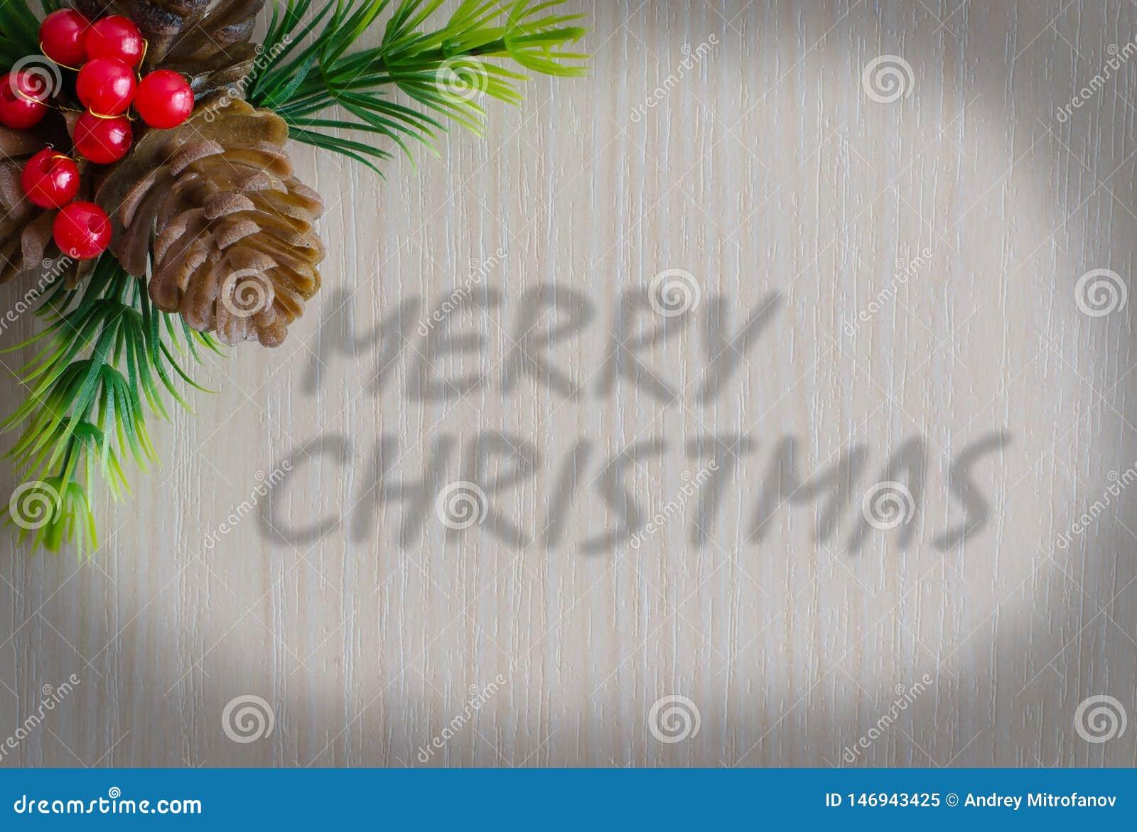 O Feliz Natal da inscri??o Fundo - textura da madeira