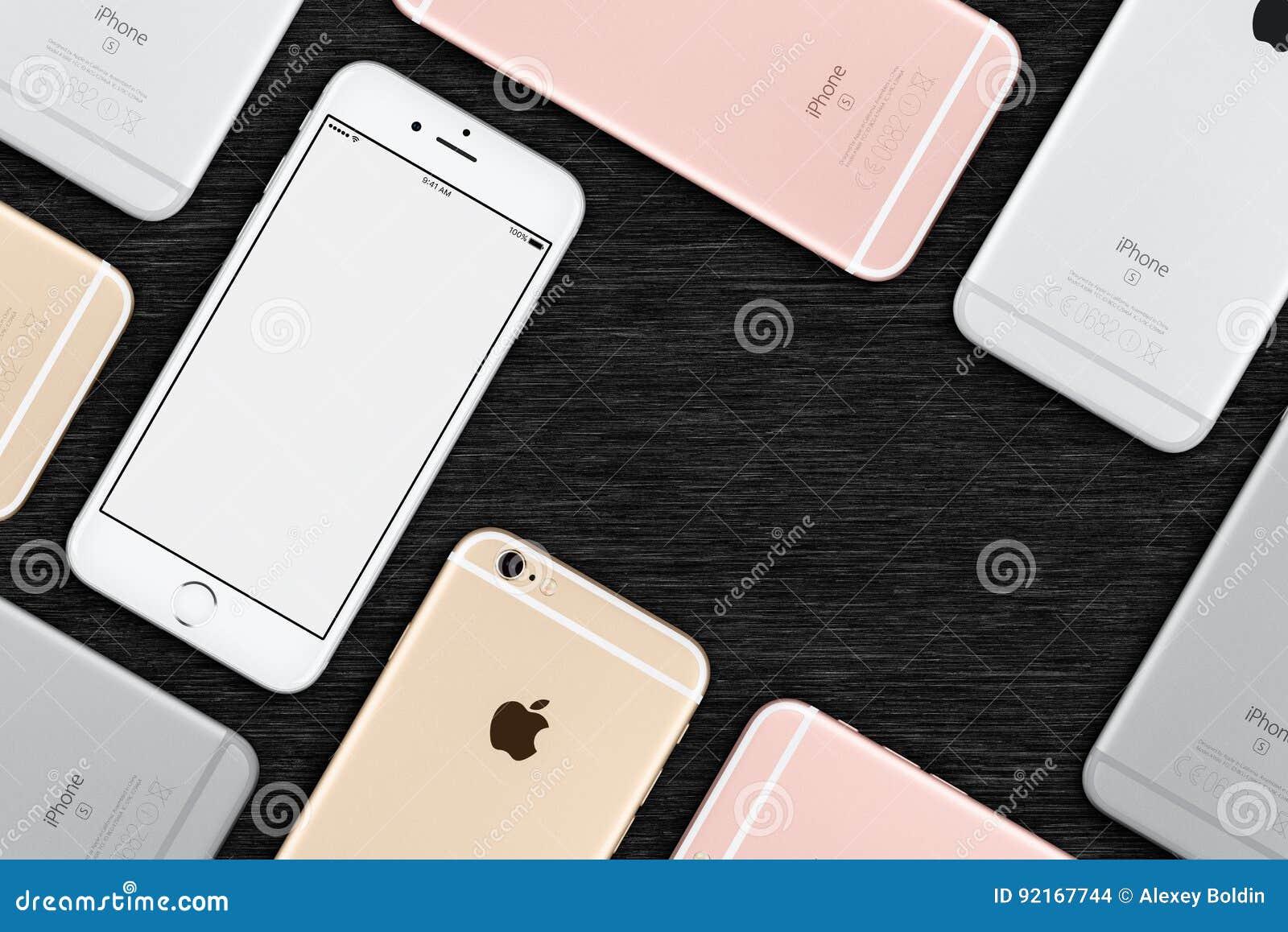 O grupo de opinião superior colocada dos iPhones 6s de Apple plano colorido encontra-se na mesa de escritório com espaço da cópia