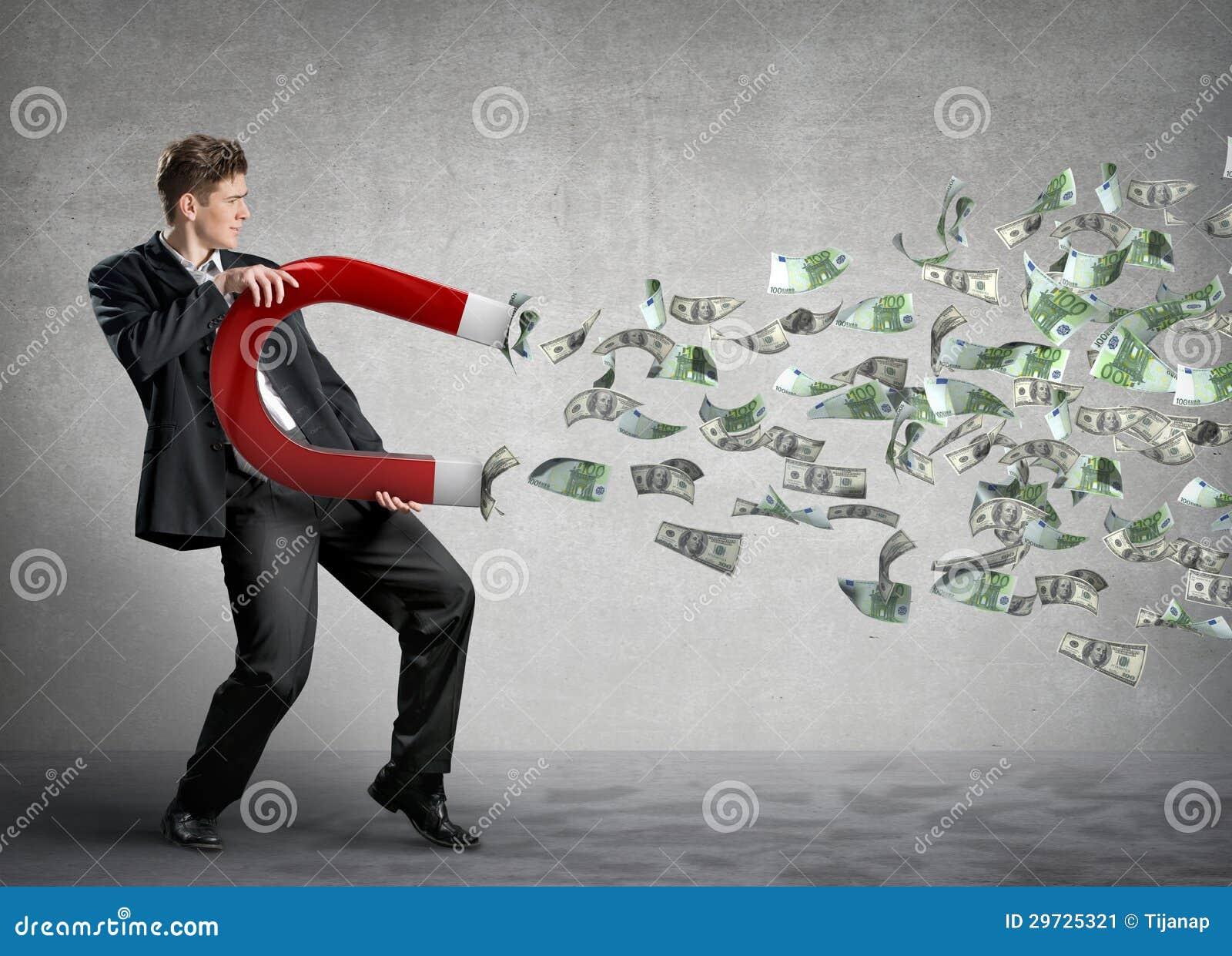 O homem de negócios atrai o dinheiro