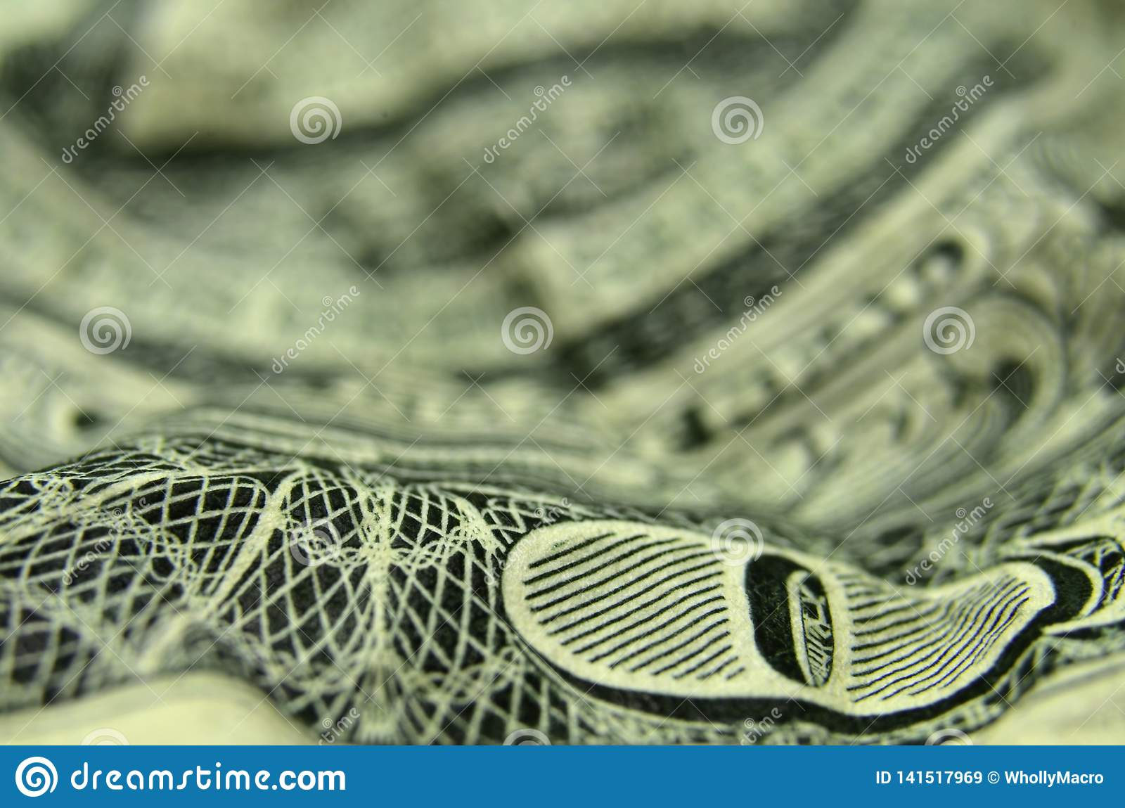 The O of ONE on the US dollar bill.