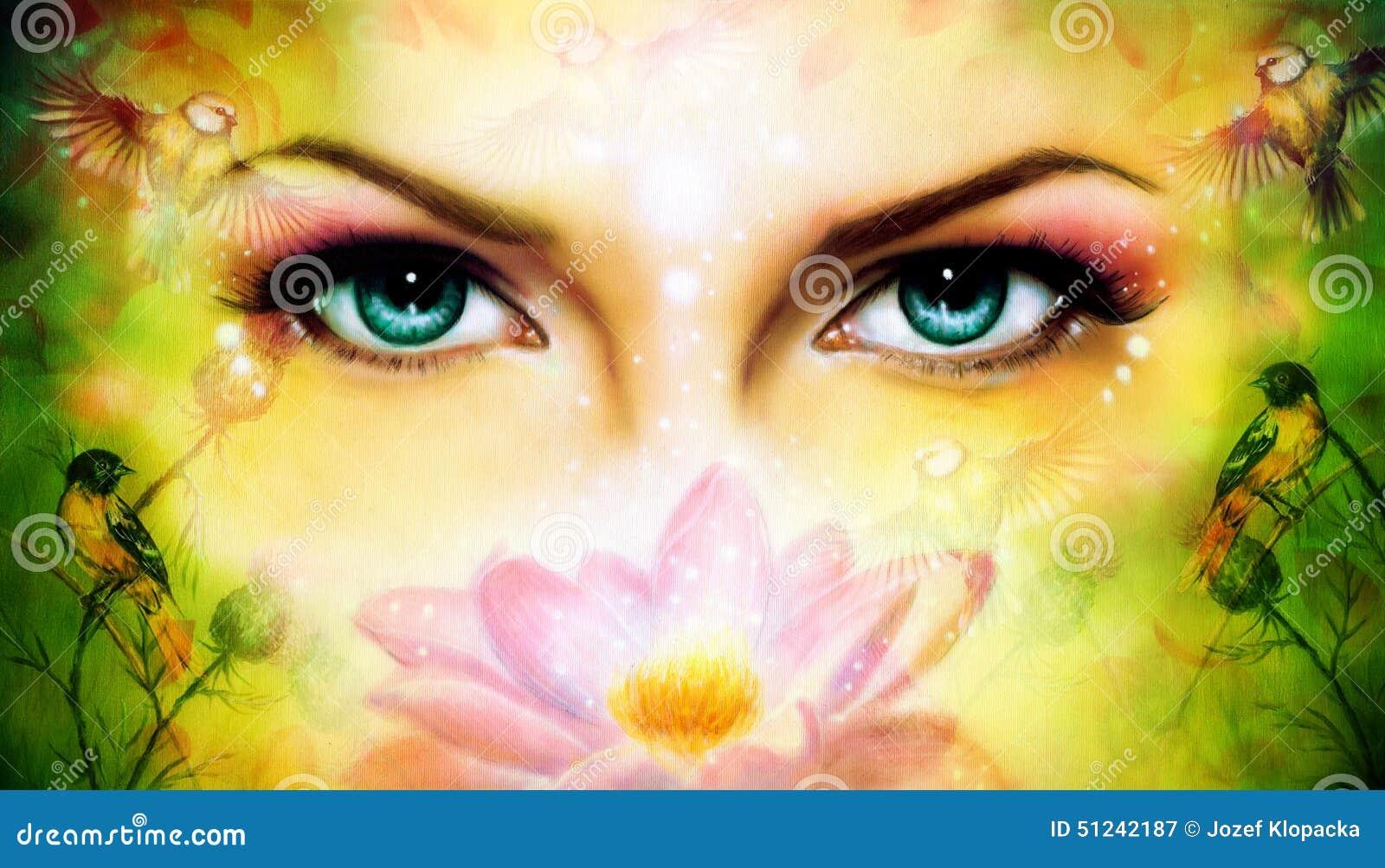 O par de mulheres azuis bonitas eyes a irradiação acima de encantar