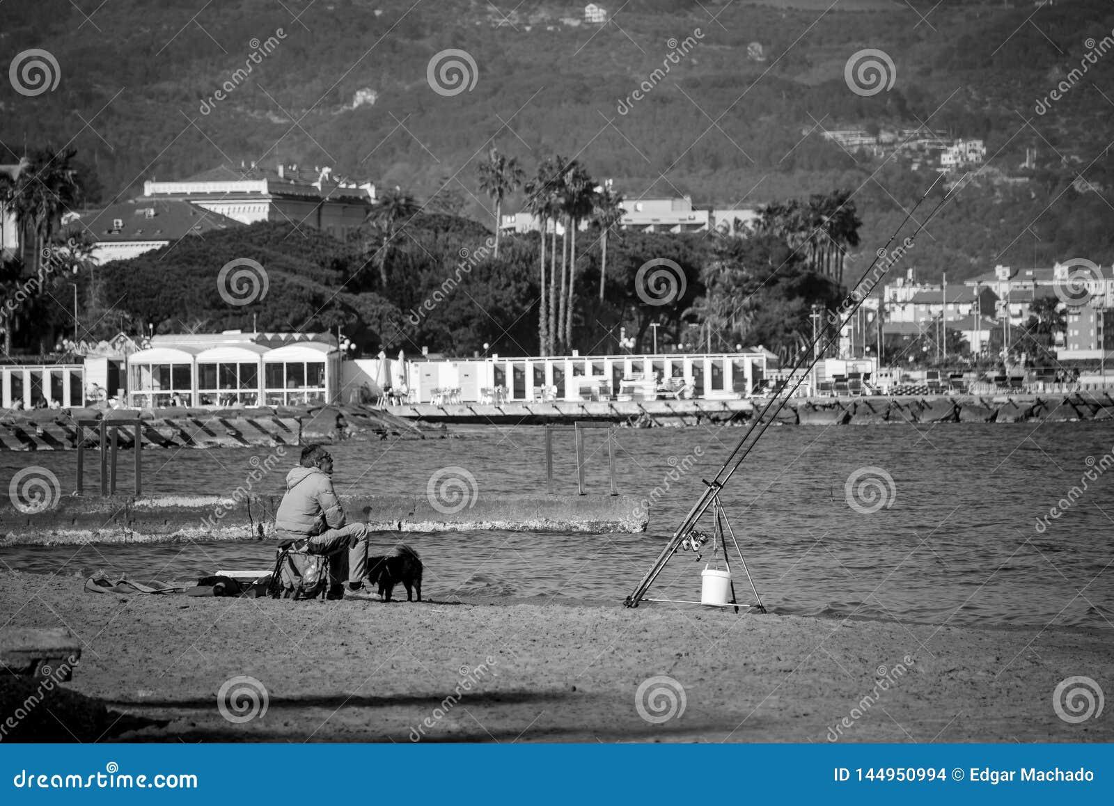 O pescador e é cão
