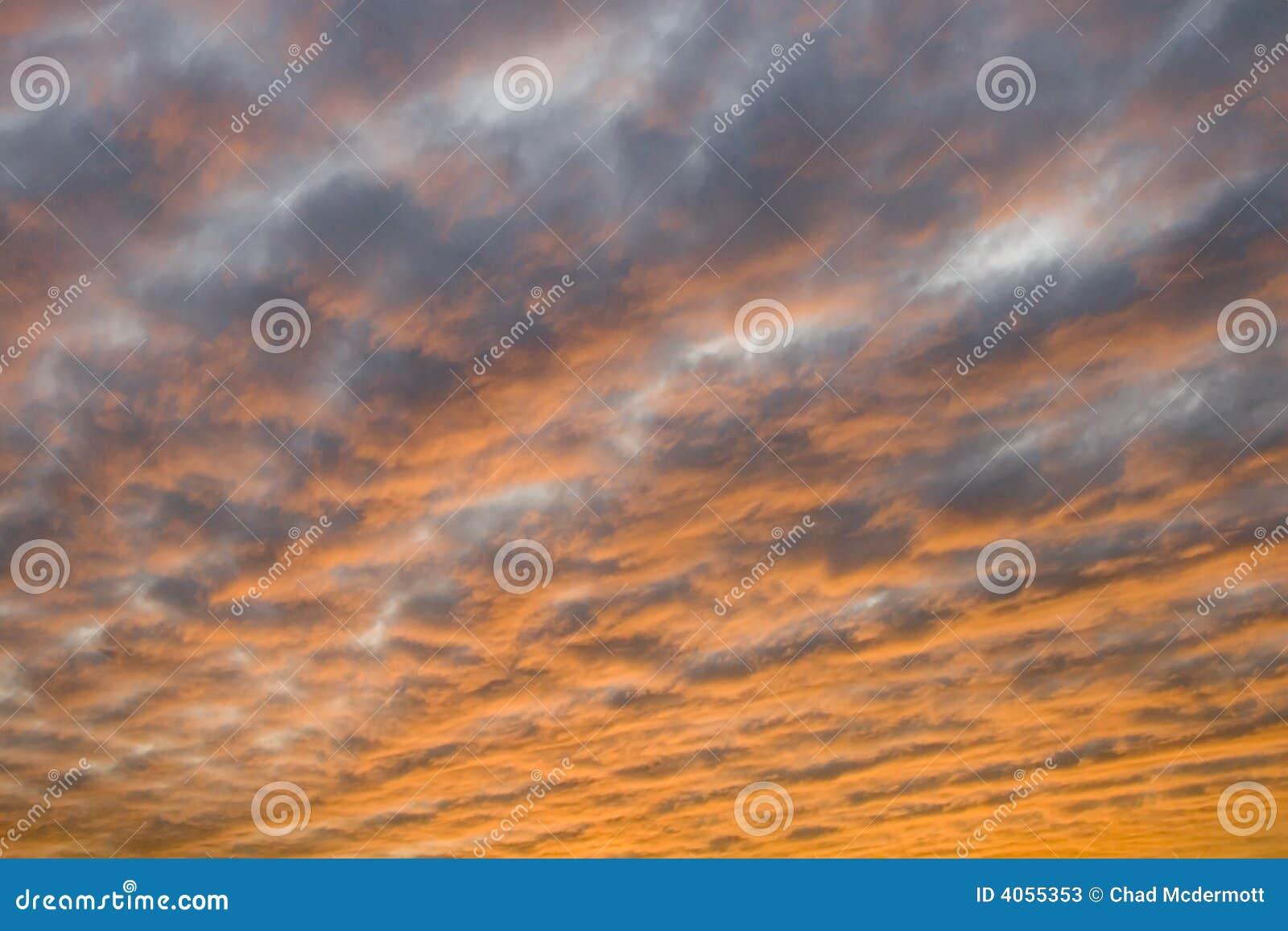 O por do sol nubla-se o fundo
