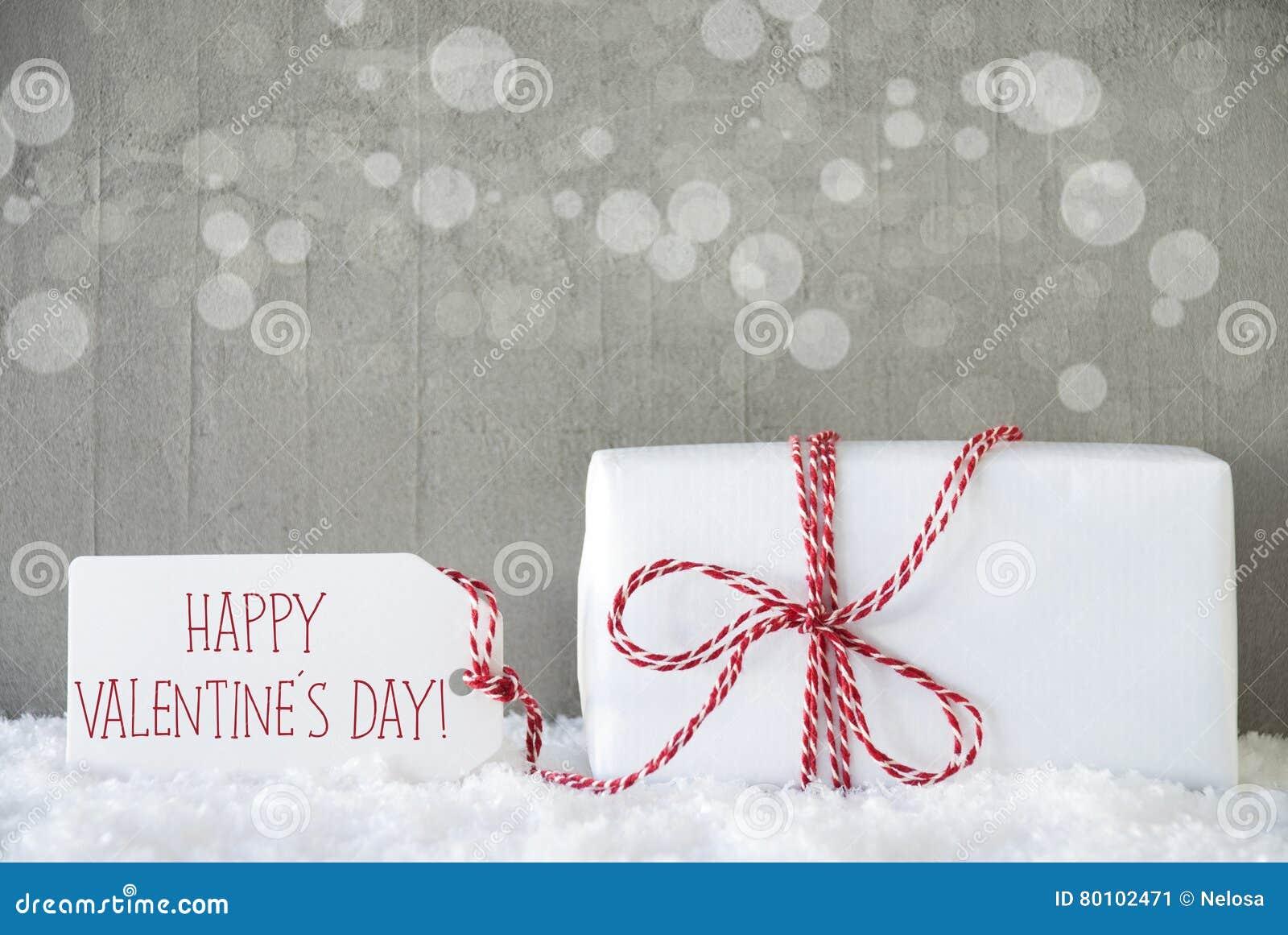 O presente, fundo do cimento com Bokeh, Text o dia de Valentim feliz
