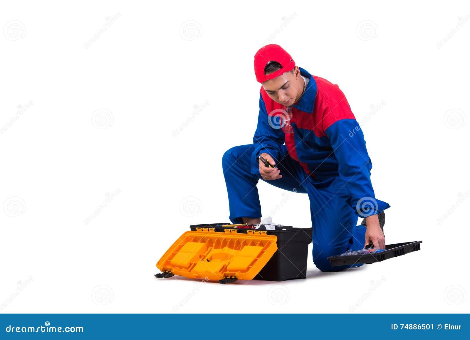 O reparador novo com a chave inglesa da chave isolada no branco