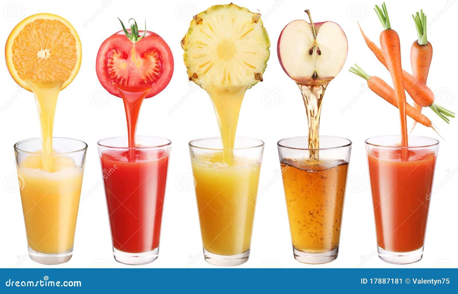 O suco fresco derrama das frutas e verdura