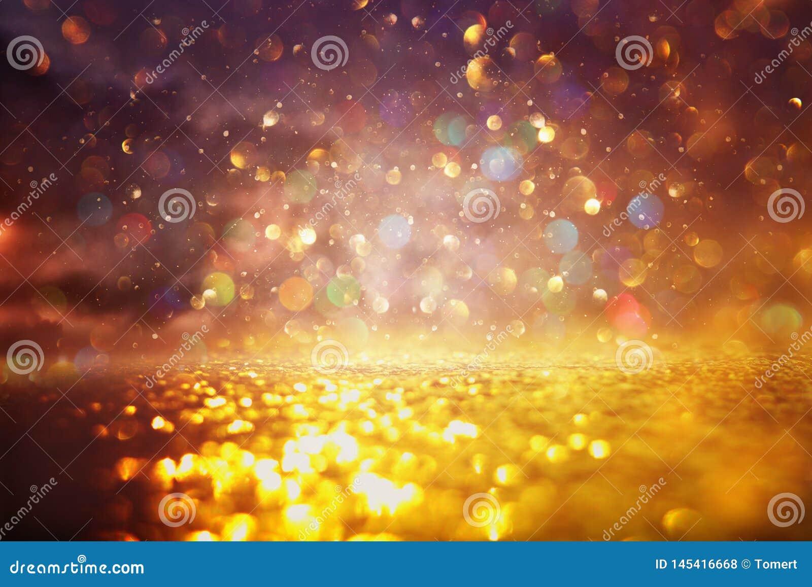 O vintage do brilho ilumina o fundo Preto e ouro de-focalizado