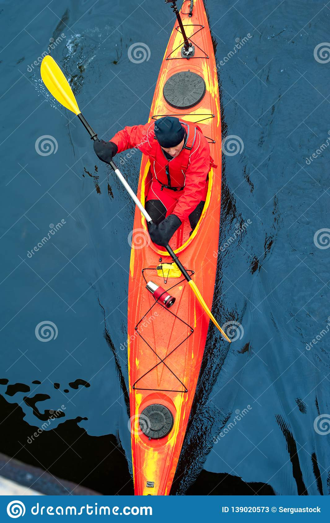 Oarsman In Red Sports Canoe Rafting On Deep River Stock