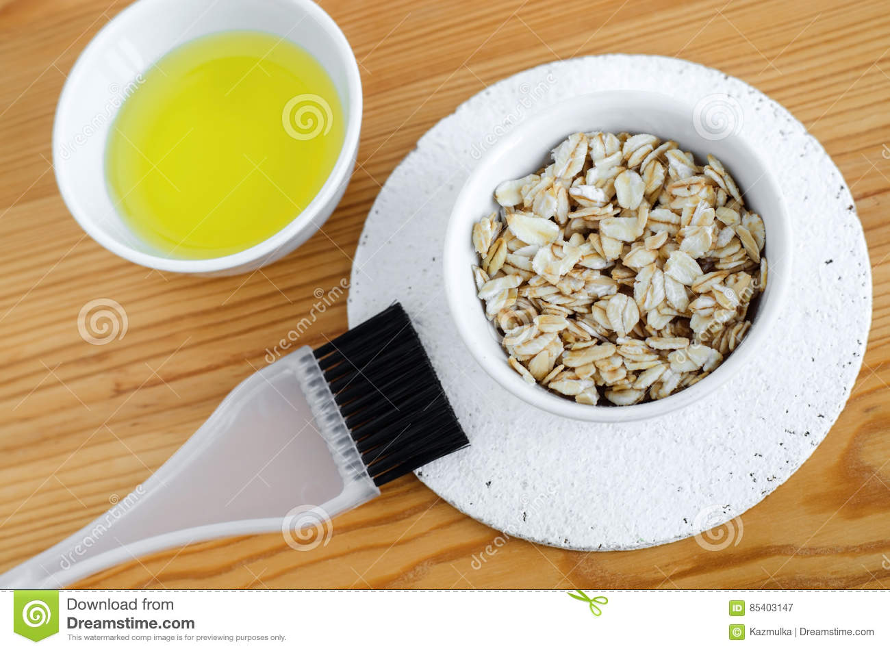 Oat Flakes And Olive Oil In A Small Ceramic Bowls For Preparing