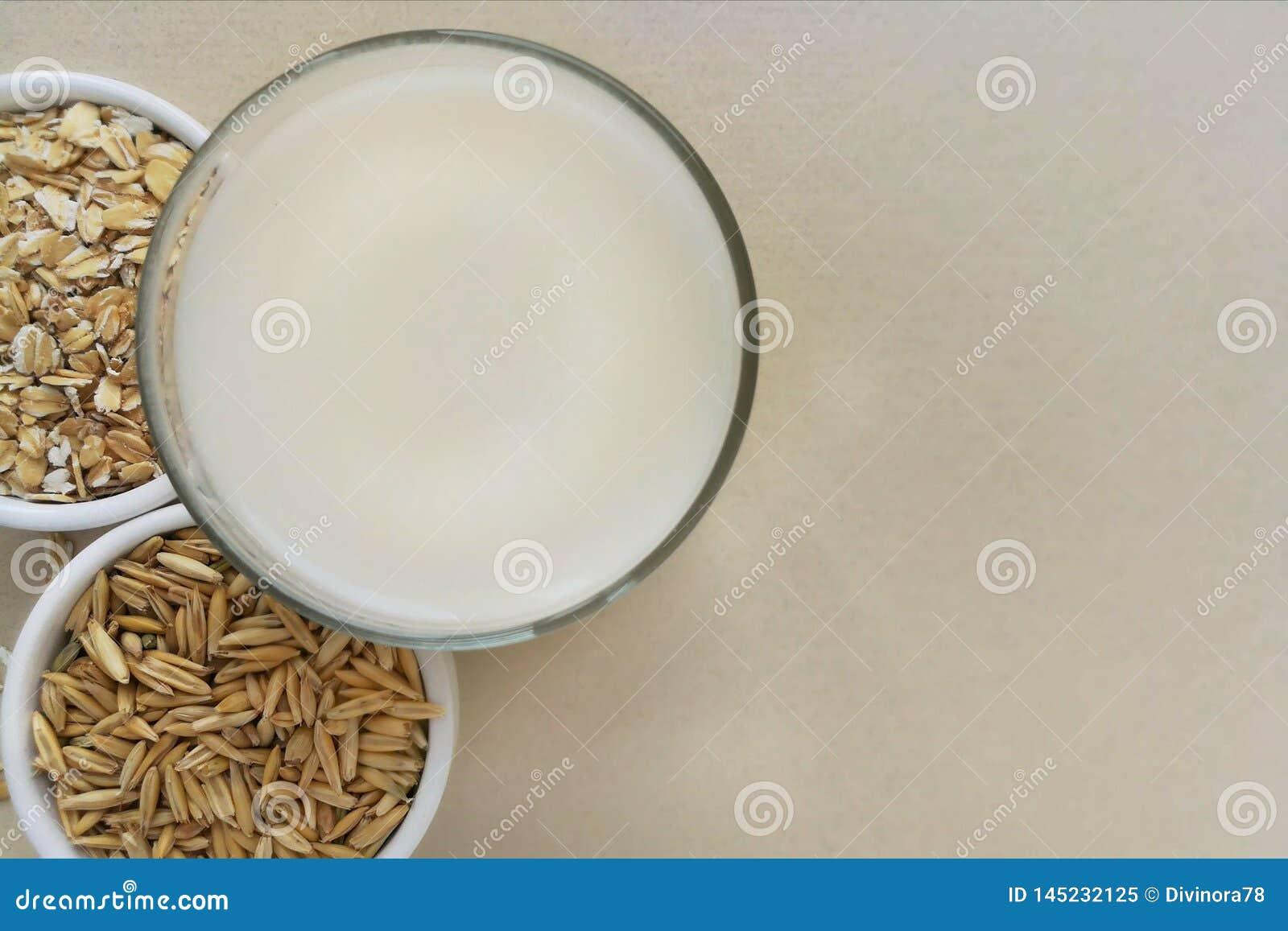 Oatmeal, oatmeal flakes and oats grains.