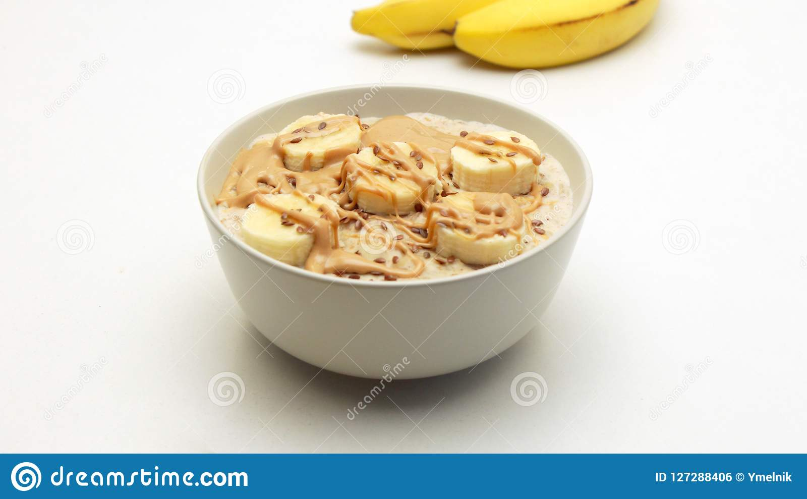 Oatmeal Porridge Bowl with Banana and Nut Butter.