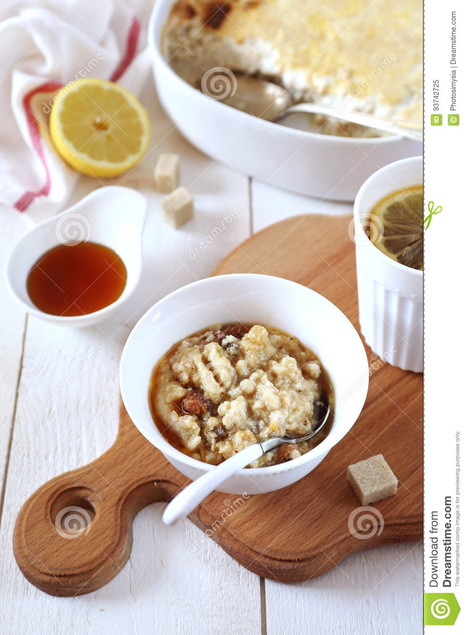 Oatmeal pudding with raisins and cinnamon, maple syrup dressing