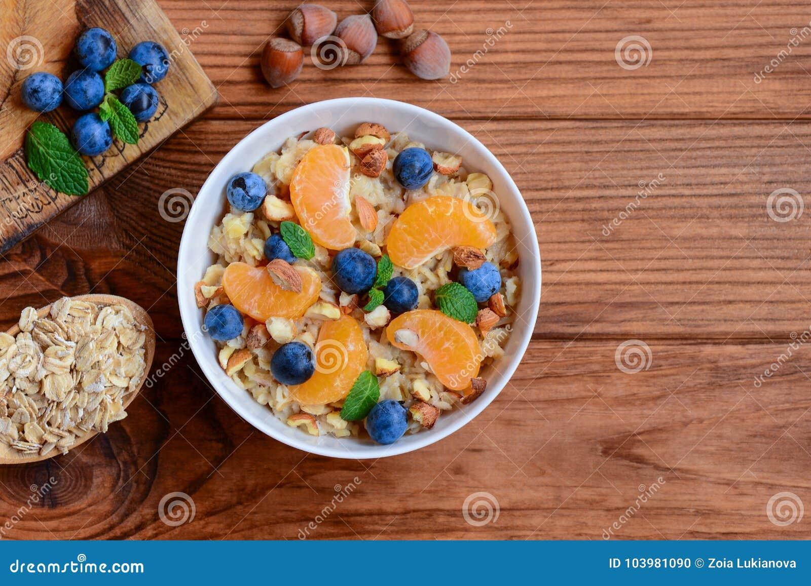 Oats Porridge Without Sugar. Porridge With Fresh Tangerines ...